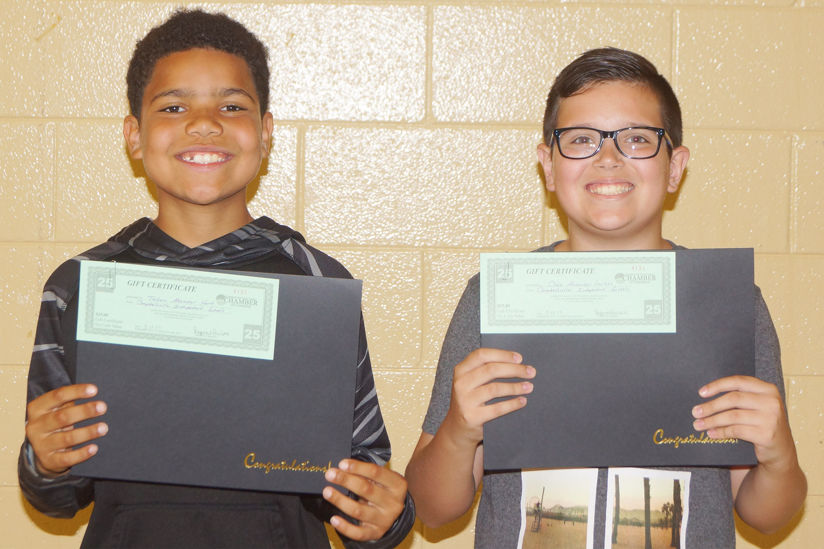 Perfect attendance awards went to fifth-graders Tashaun Hart, at left, and Chase Lawless.