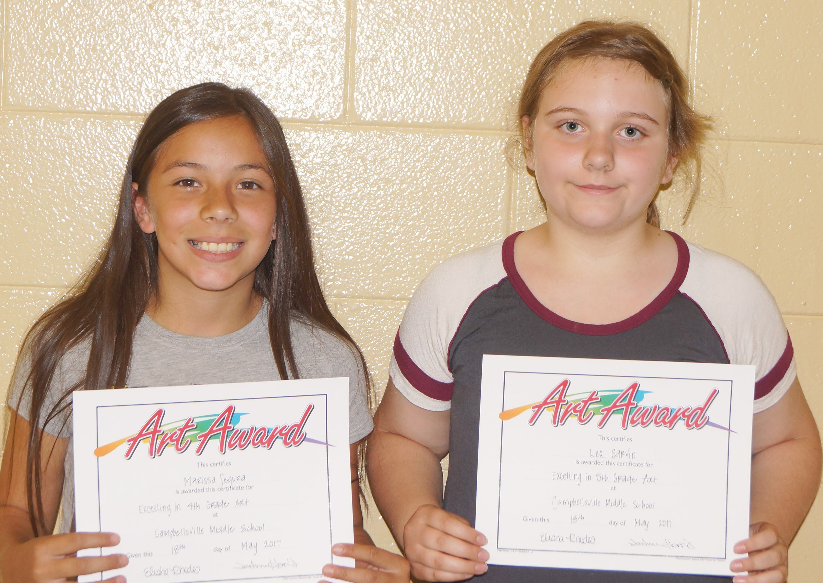 Art award winners are fourth-grader Marissa Segura, at left, and fifth-grader Lexi Garvin.