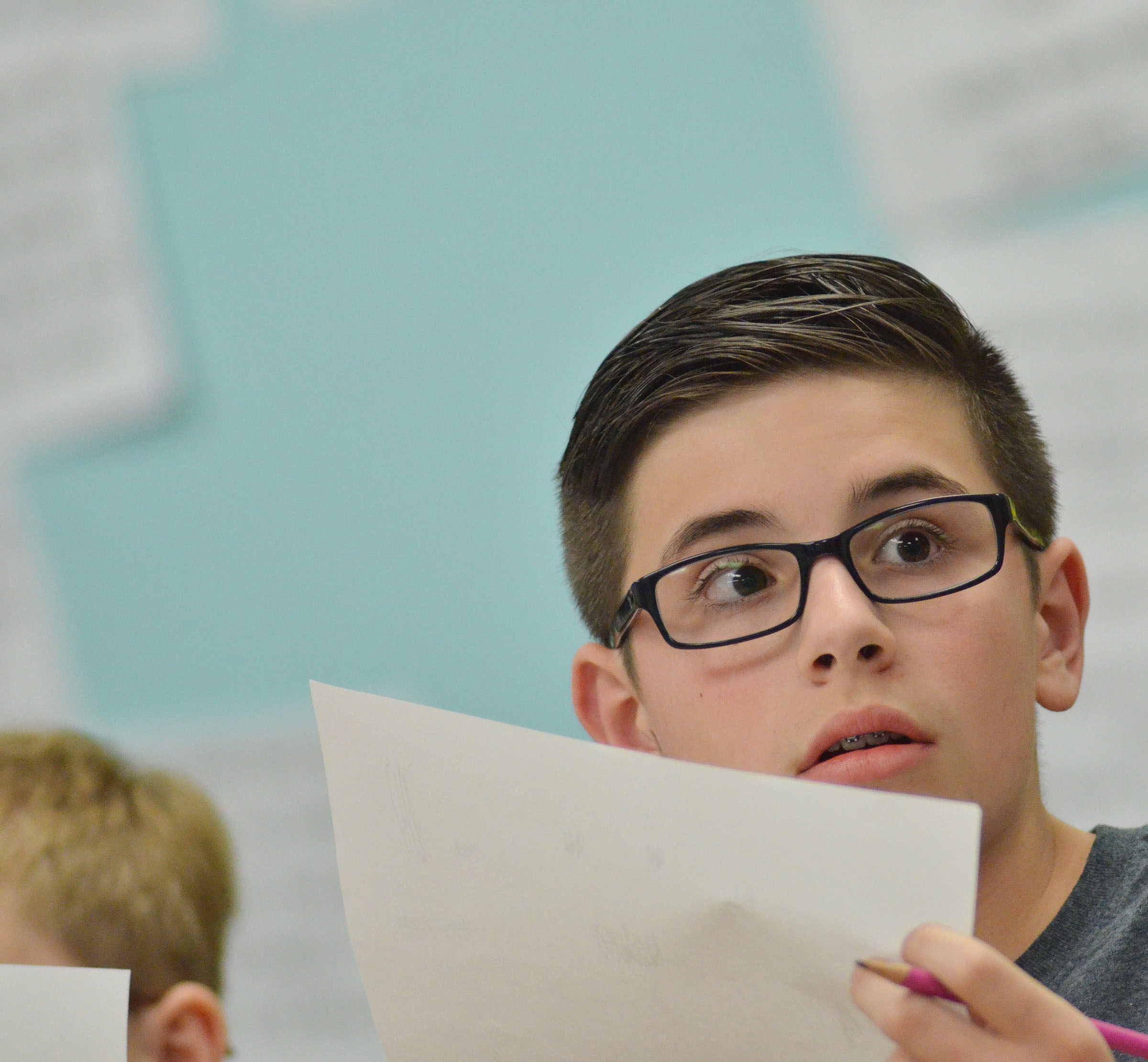 CMS fifth-grader Isaac Garrison listens to a question during a quick recall match.