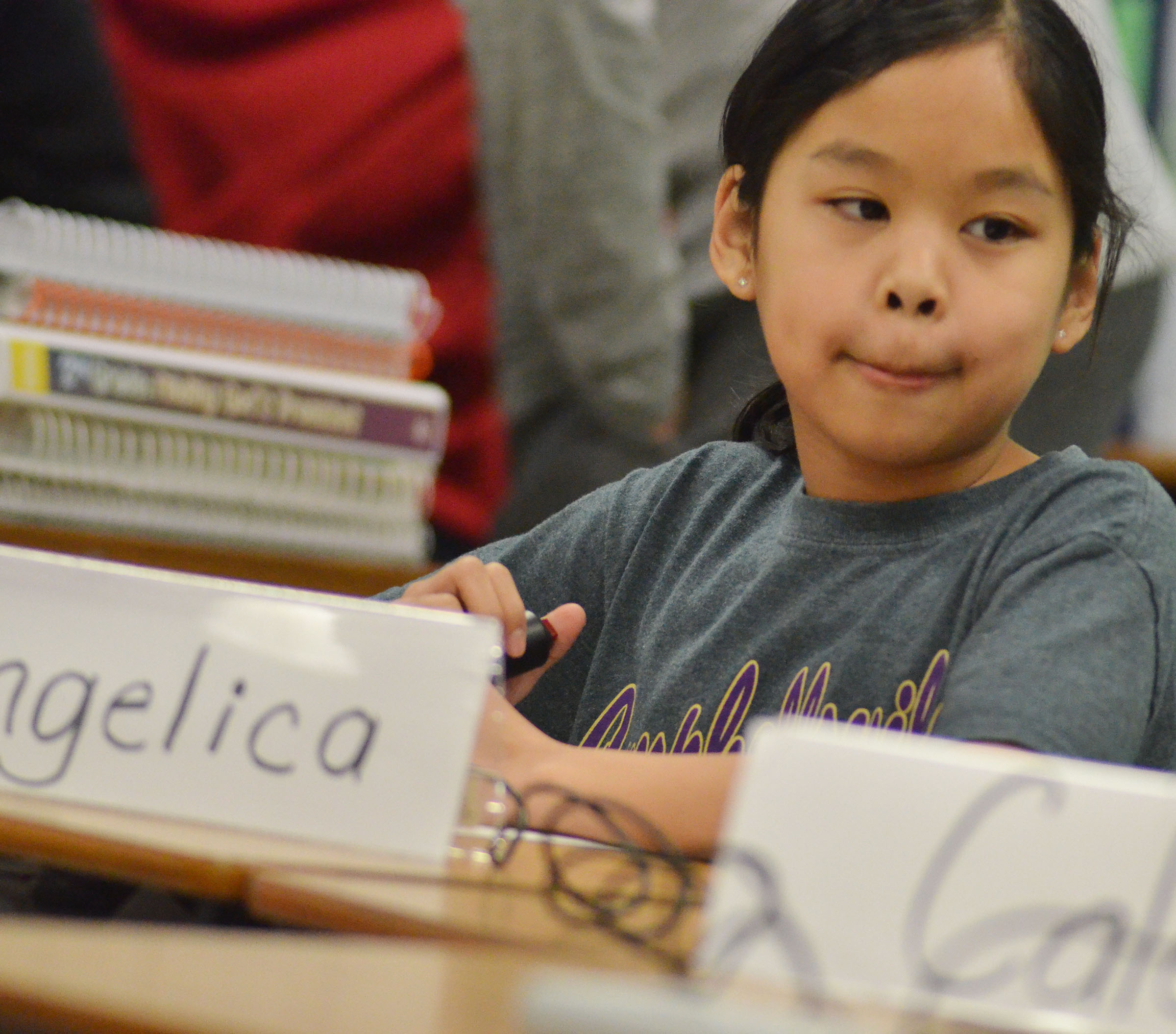 CMS fifth-grader Angelica Seng listens to a question during a quick recall match.