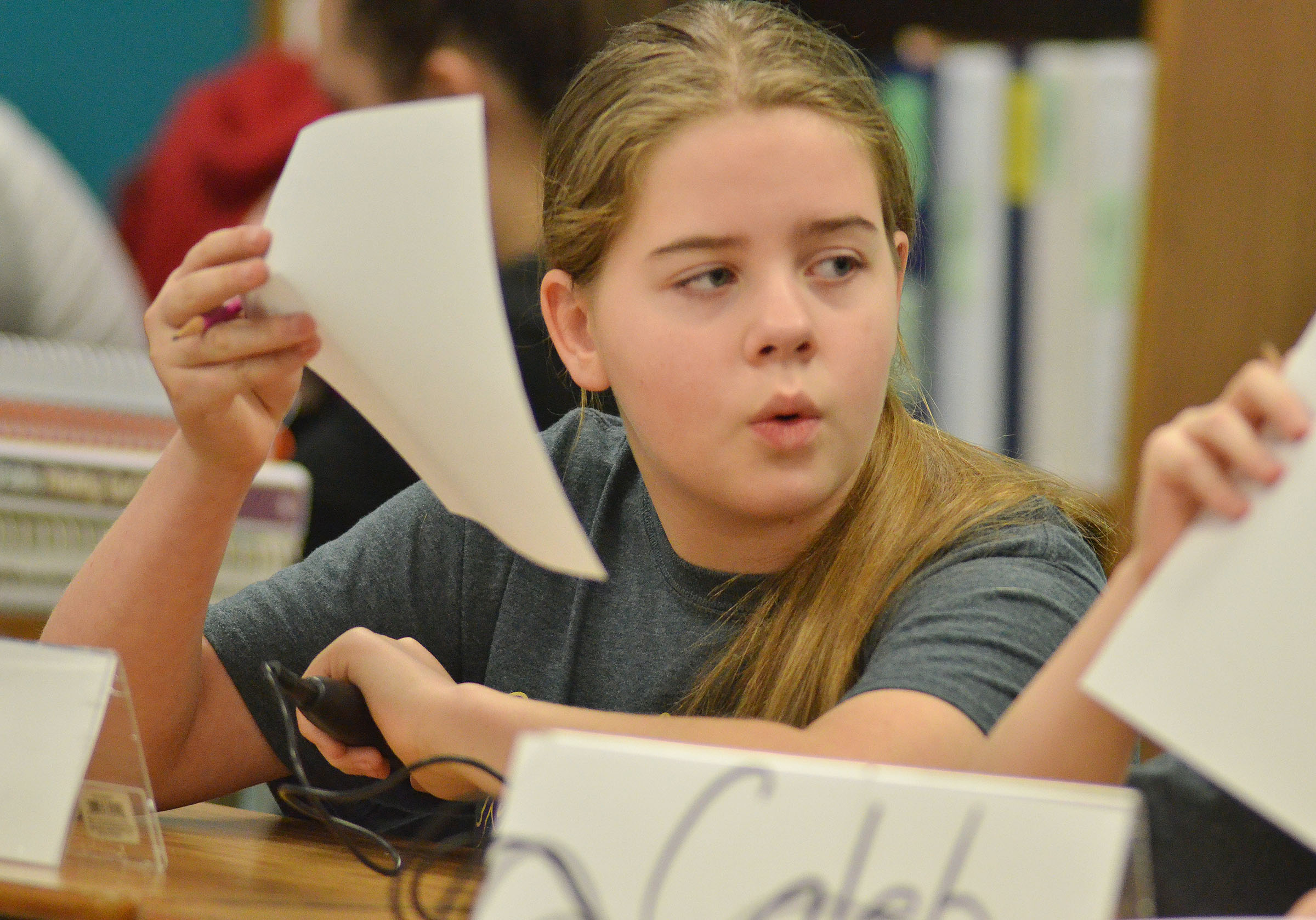 CMS fifth-grader Layla Steen discusses a question with her teammates during a quick recall match.