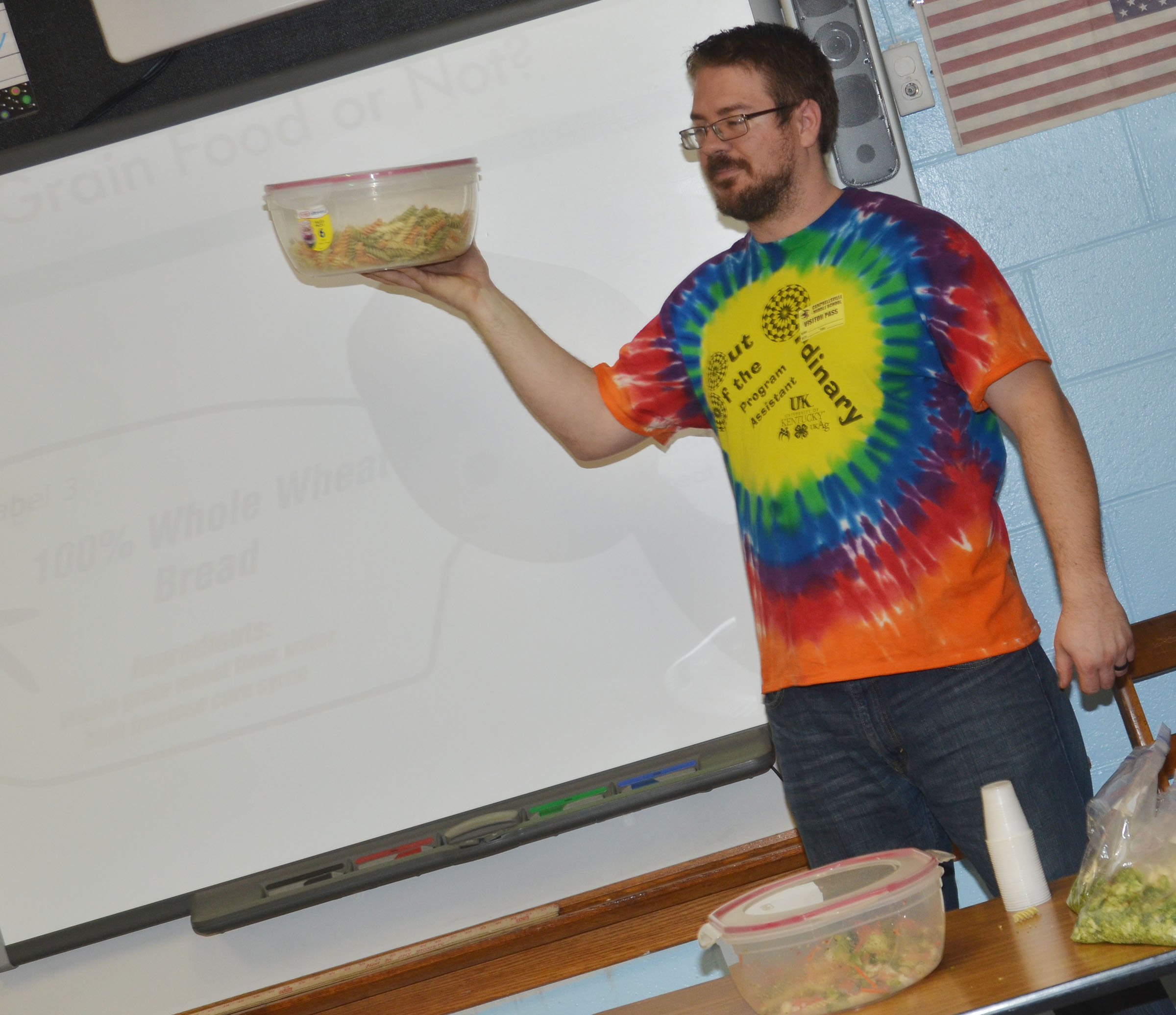 Jordan Stapp, 4-H program assistant at Taylor County Extension Office, talks to students about whole grains.