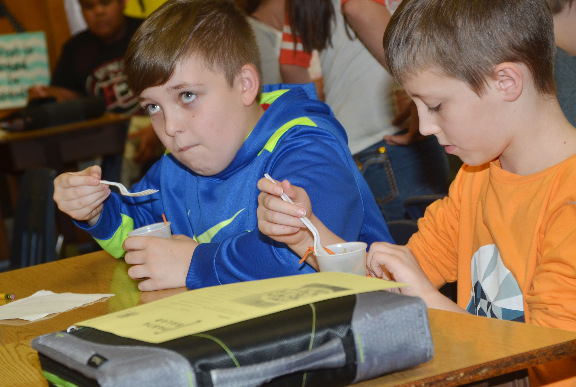 CMS fourth-graders Skylar Wilhoite, at left, and Jaxon Garrett try the class's pasta salad.