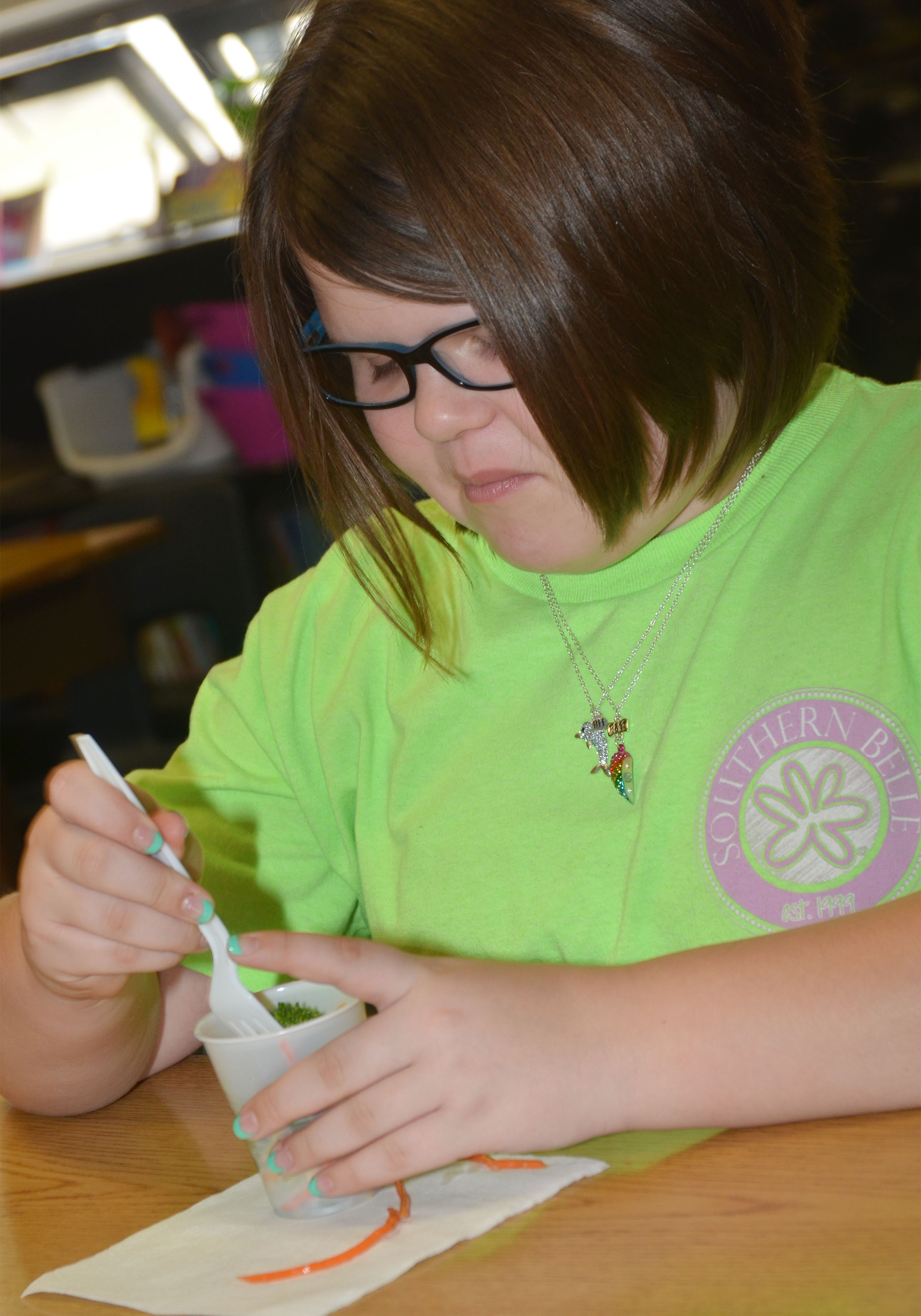 CMS fourth-grader Keeley Dicken samples the class's pasta salad.