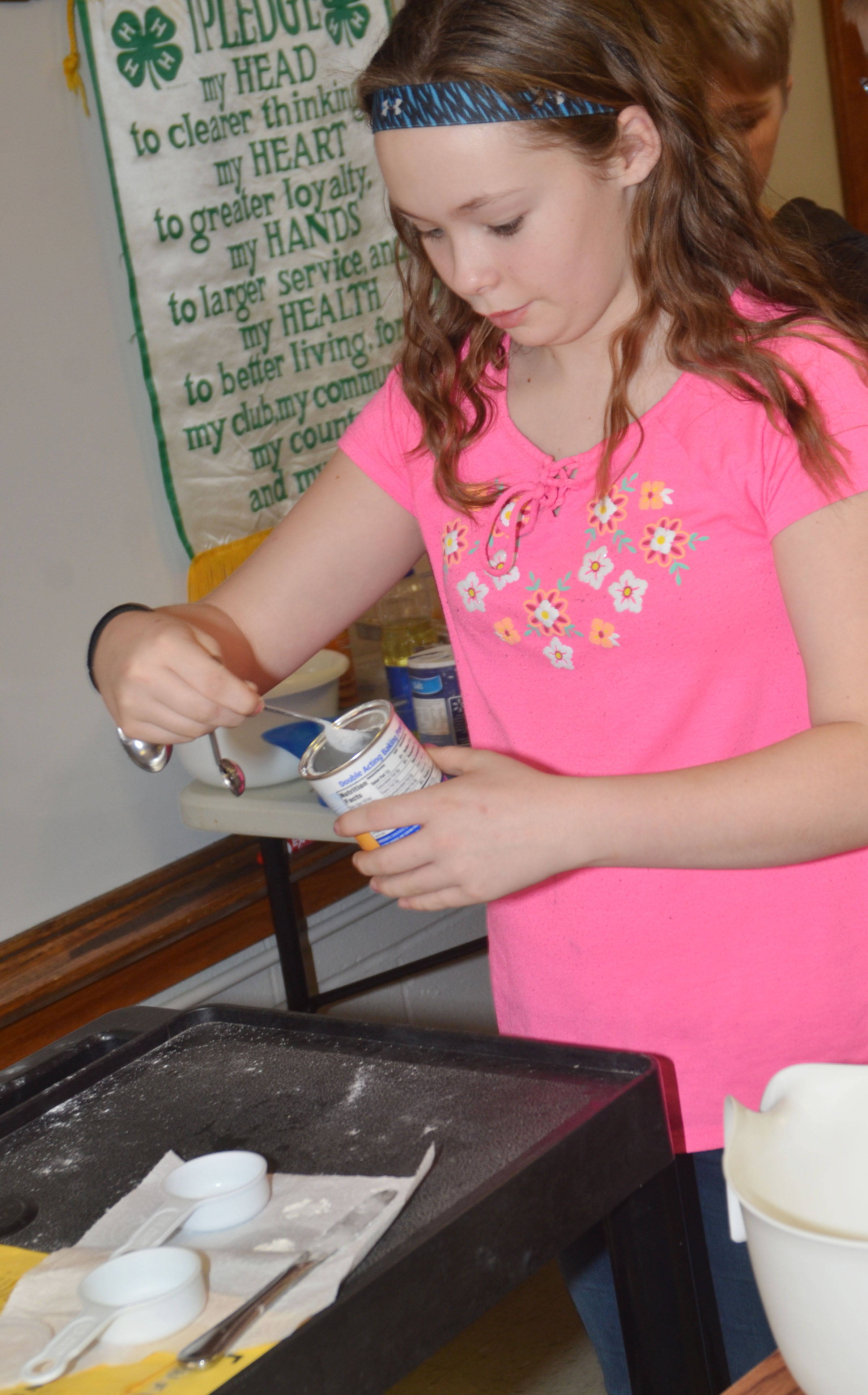 CMS fifth-grader CheyAnn Edwards measurers baking powder.