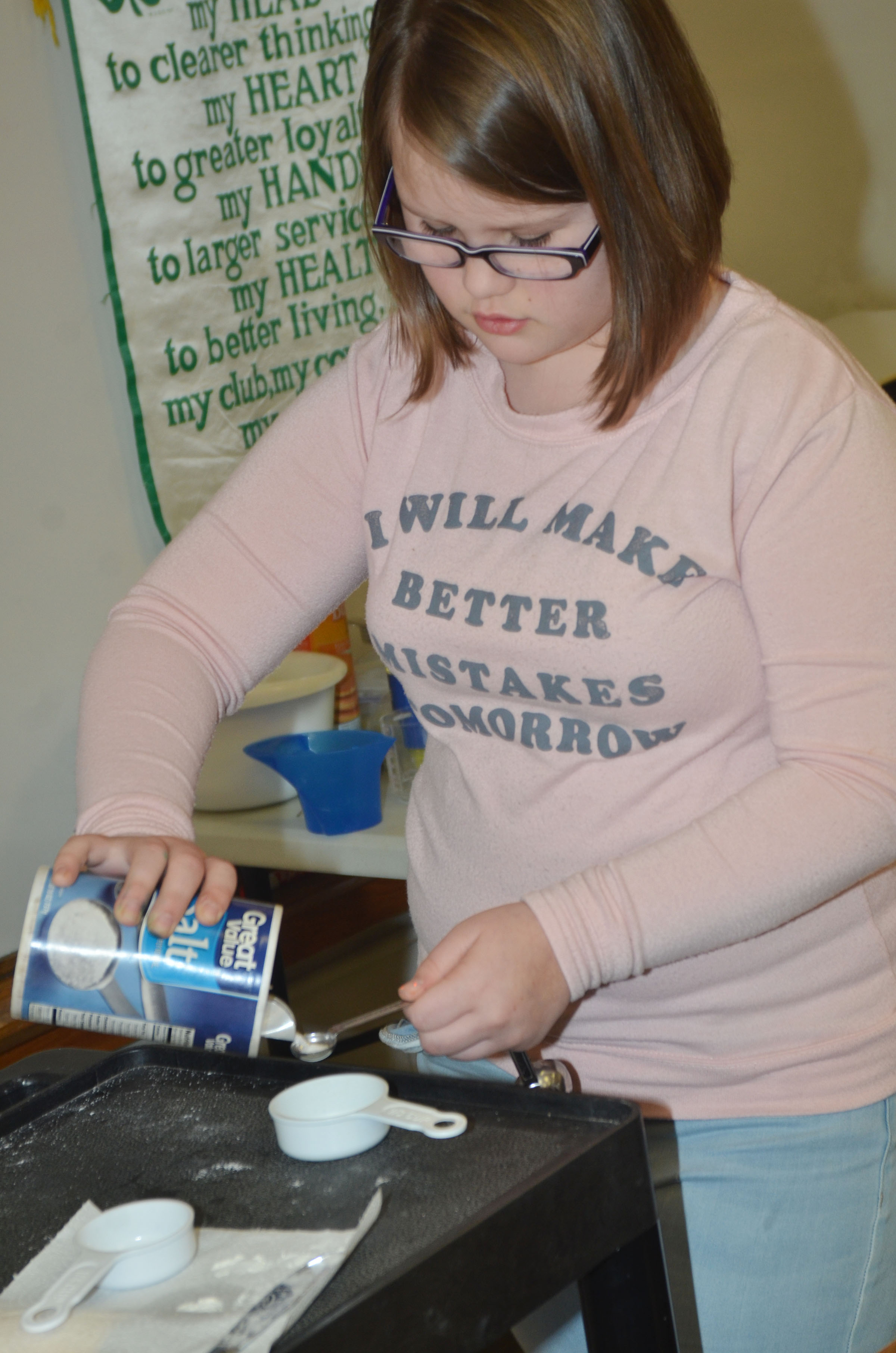 CMS fifth-grader Kylee Cox measures salt.