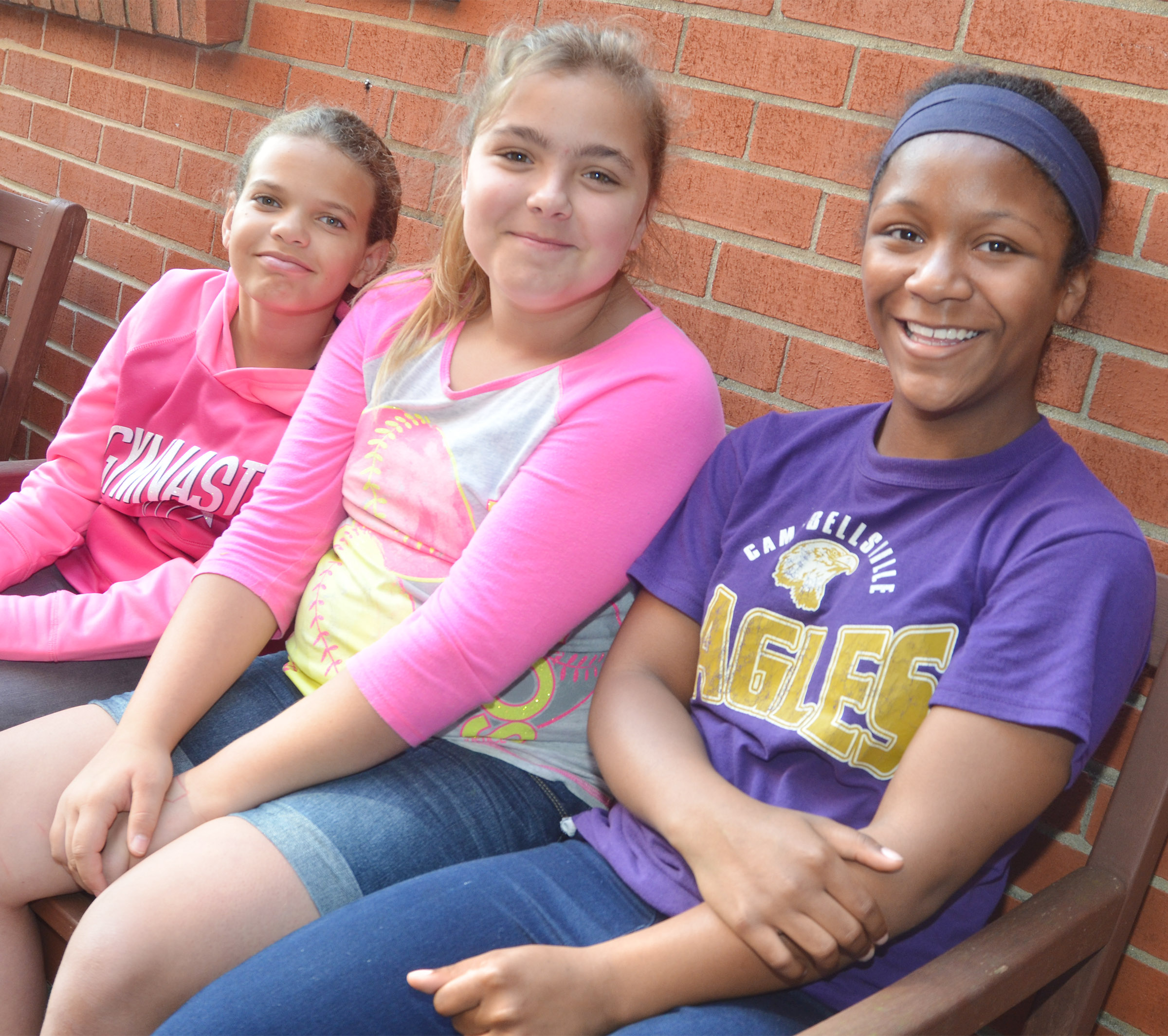 CMS fifth-graders, from left, Arisha Francis, Brooklyn Mays and Camilla Taylor enjoy their tour of the Campbellsville University campus.