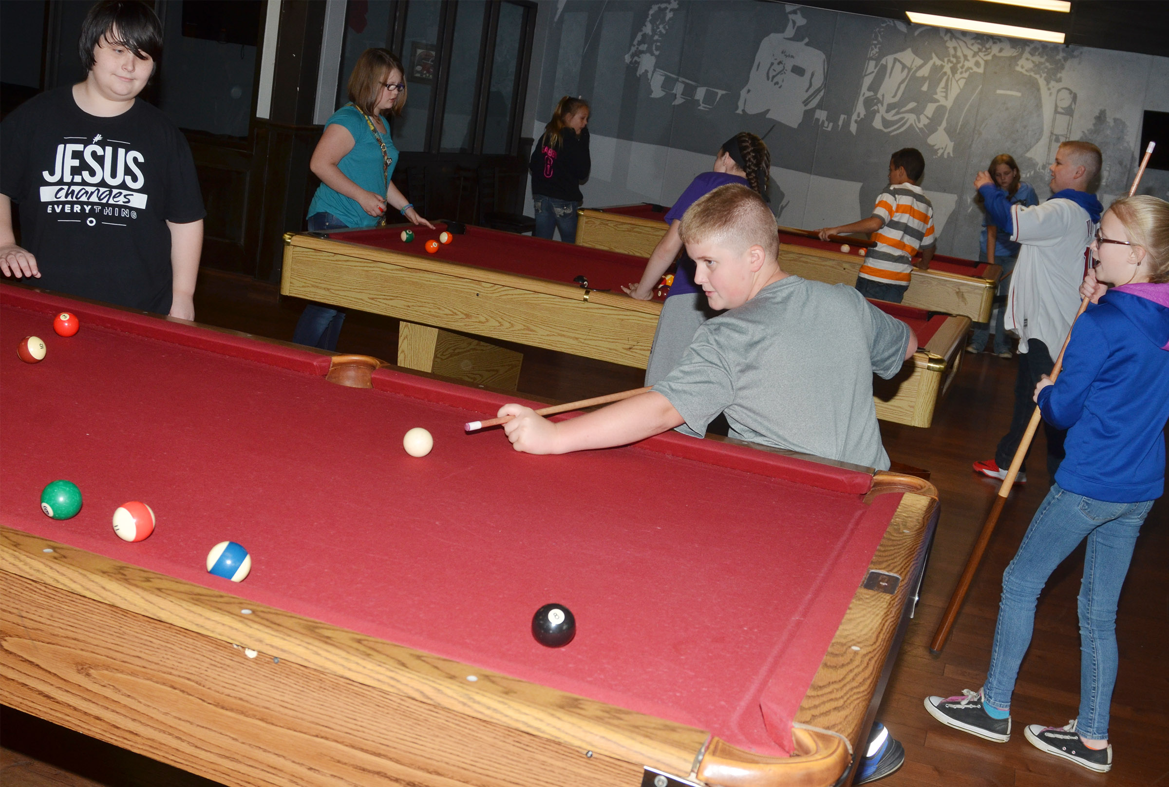CMS fifth-grader Lance Knifley plays pool with his classmates at the Student Activities Center.