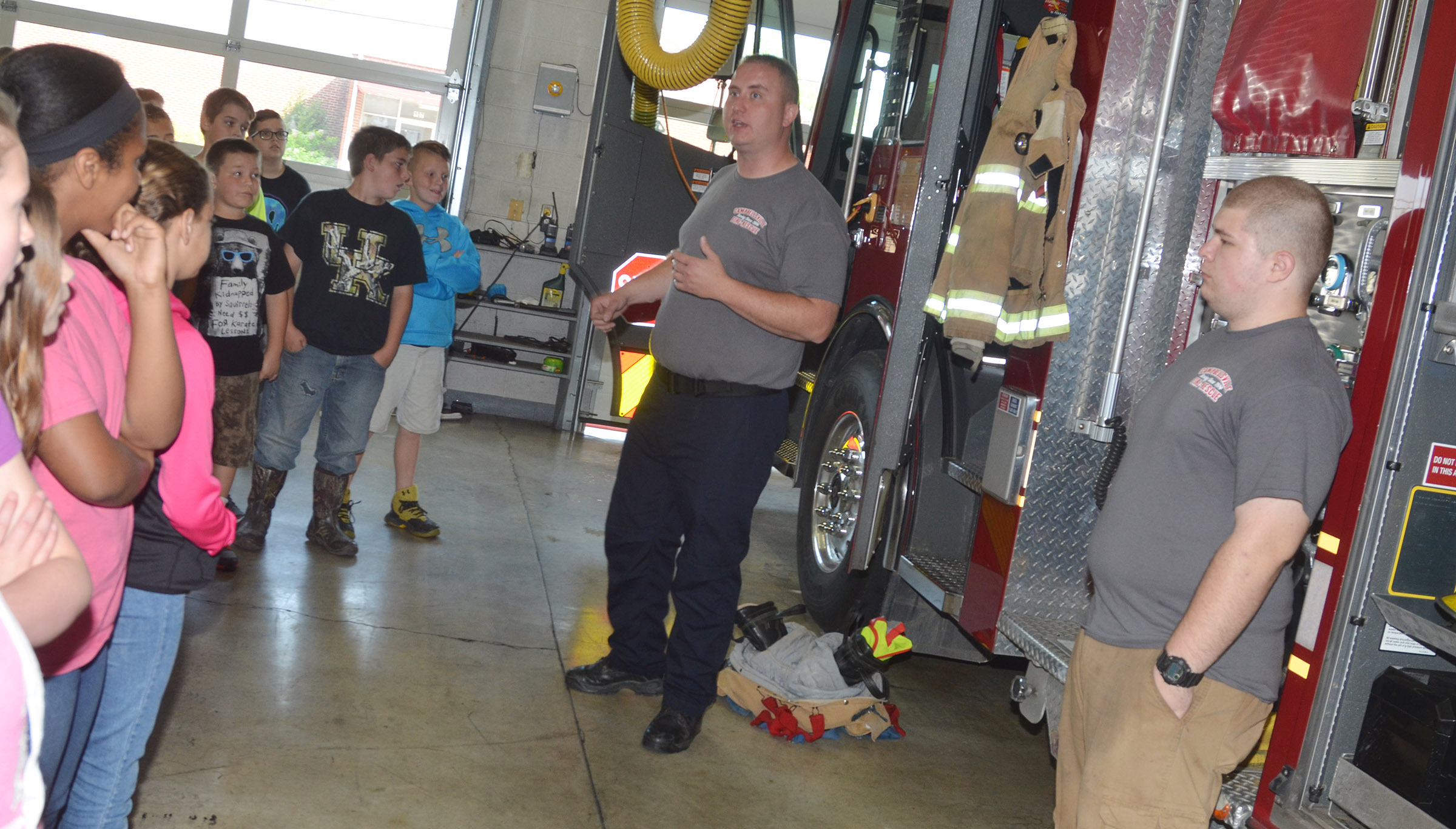 Daniel Cook, who is part of the Campbellsville Fire & Rescue Special Operations Team, talks to CMS fifth-graders about the equipment on fire trucks.