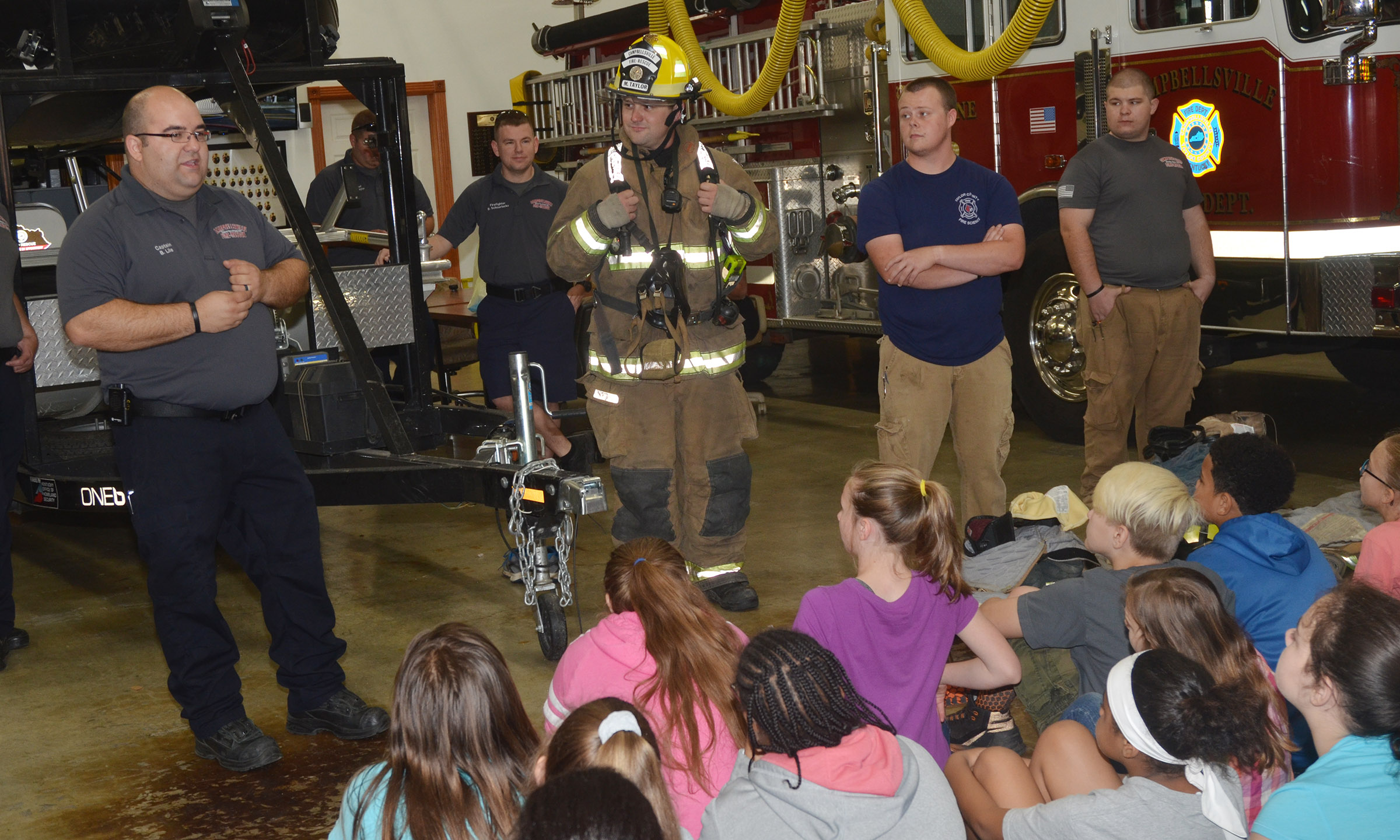 Campbellsville Fire & Rescue Captain Brent Lile tells CMS fifth-graders that they should never be afraid of firefighters.