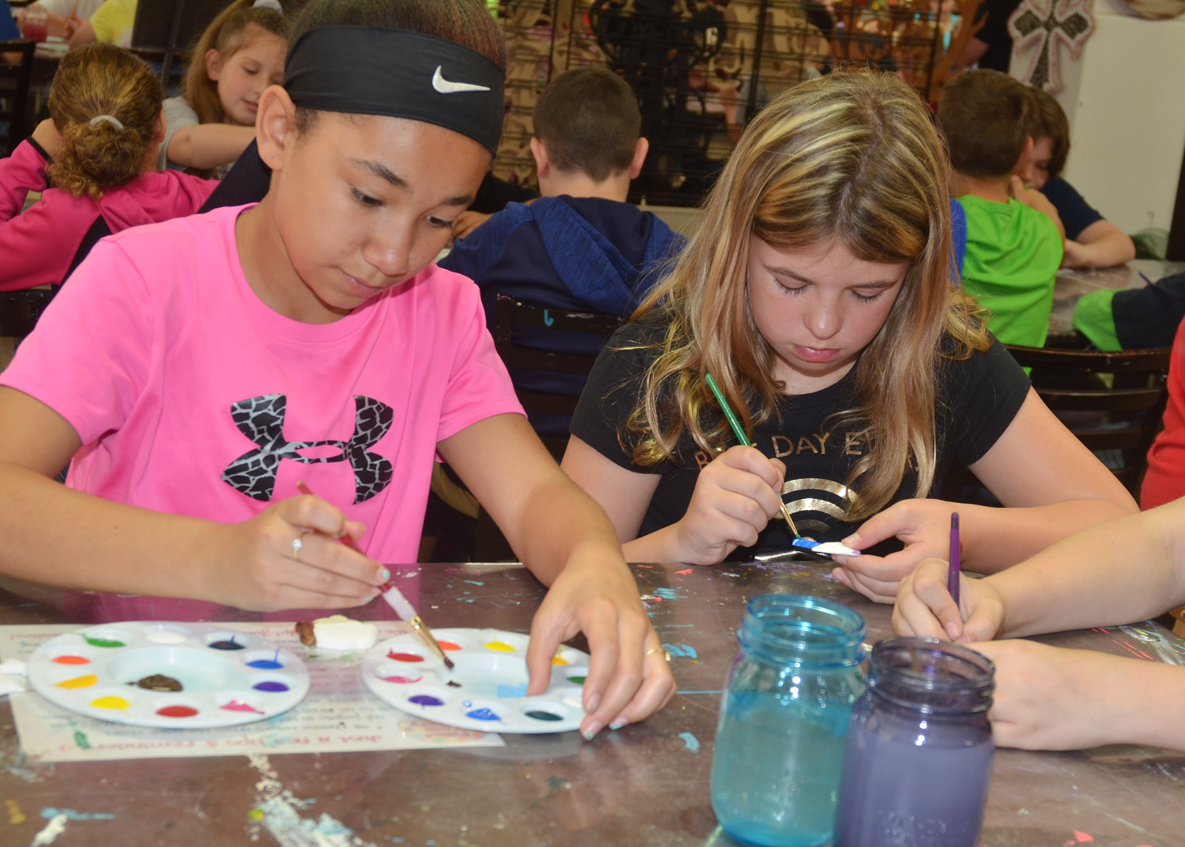 CMS fifth-graders Keely Thompson, at left, and Aryanna Britton paint.