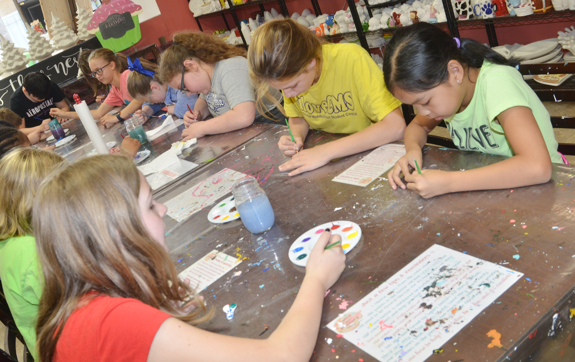 CMS fifth-graders paint together.