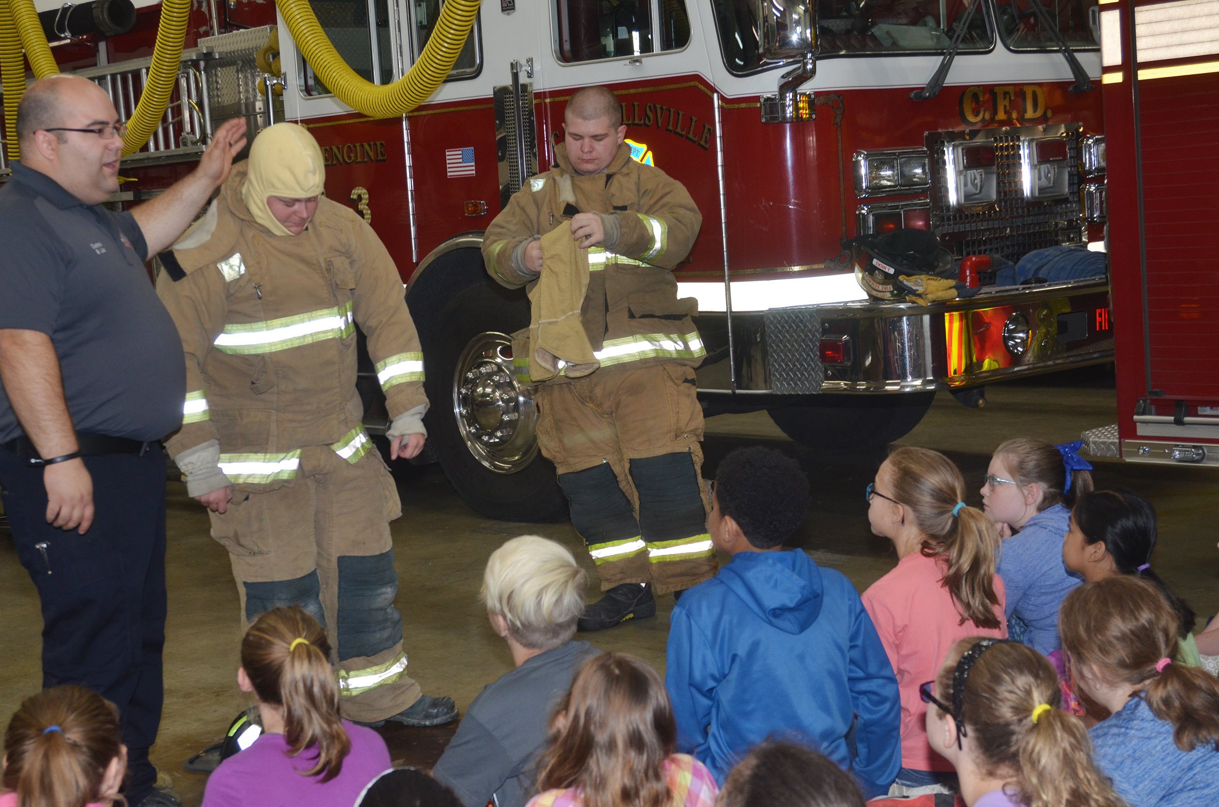 Campbellsville Fire & Rescue Captain Brent Lile talks to CMS fifth-graders about the turnout gear firefighters wear.