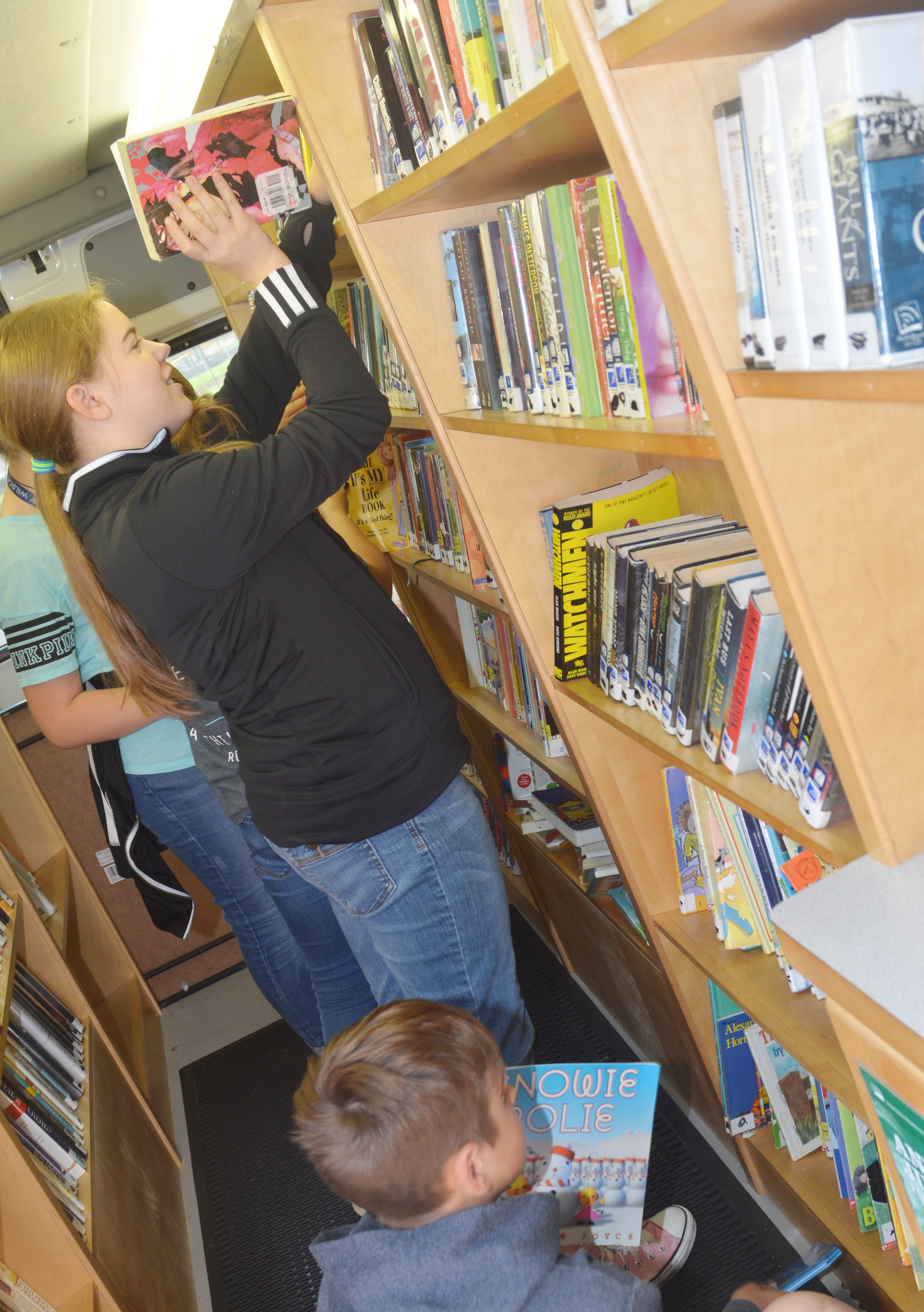 CMS sixth-grader Layla Steen looks for a book.