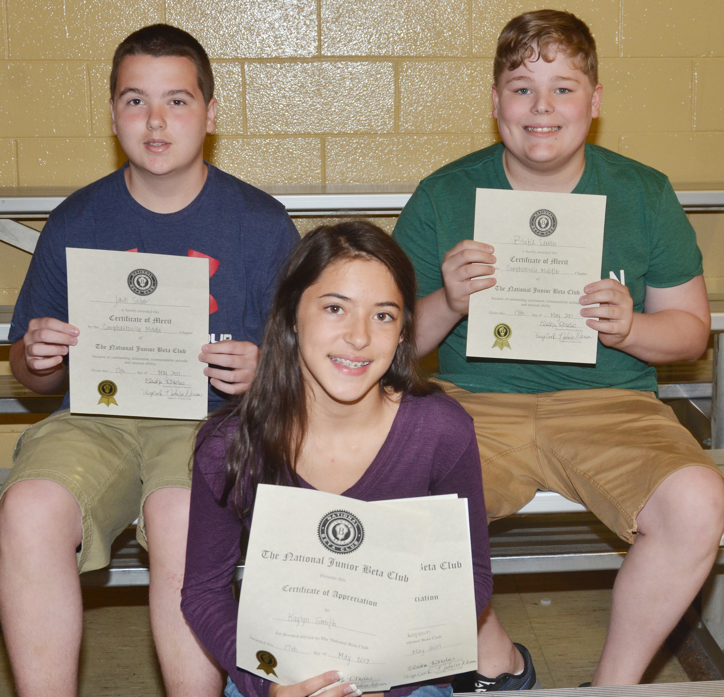 Beta awards went to seventh-grader Kaylyn Smith, in front, who ran for the state chaplain office. Back, seventh-graders Jack Sabo, at left, and Blake Settle.