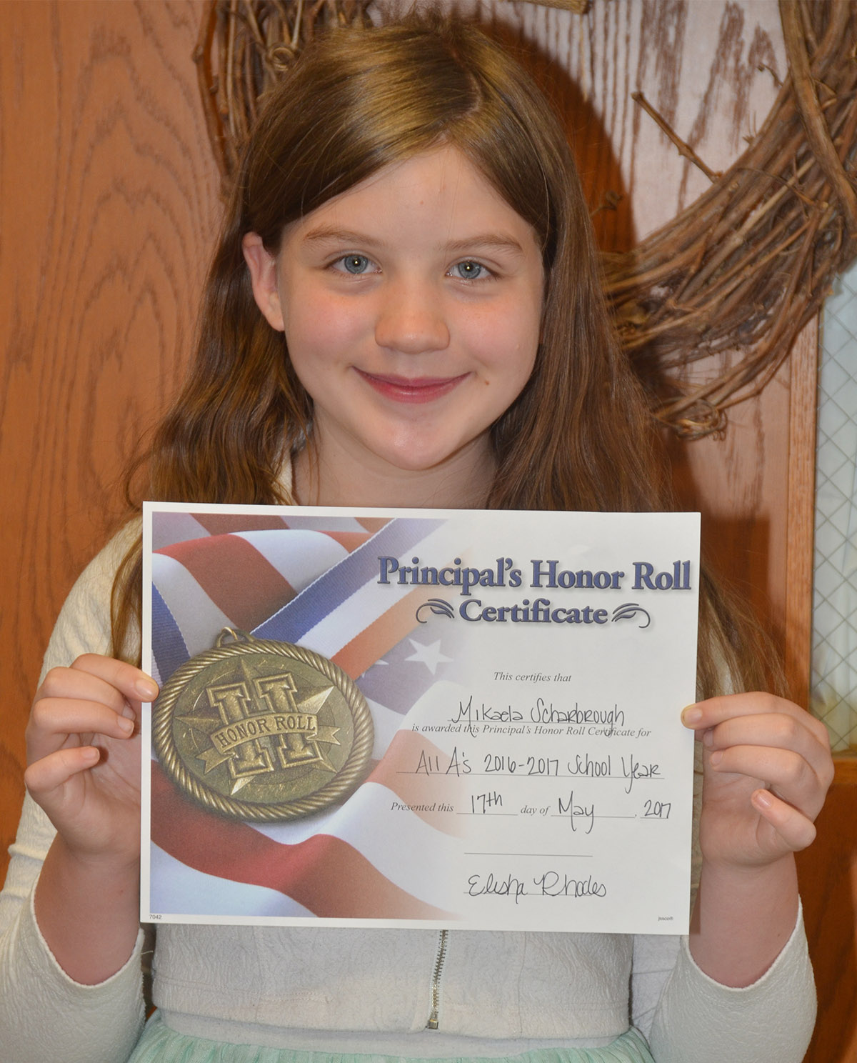 Sixth-grader Mikaela Scharbrough received a principal's honor roll award.