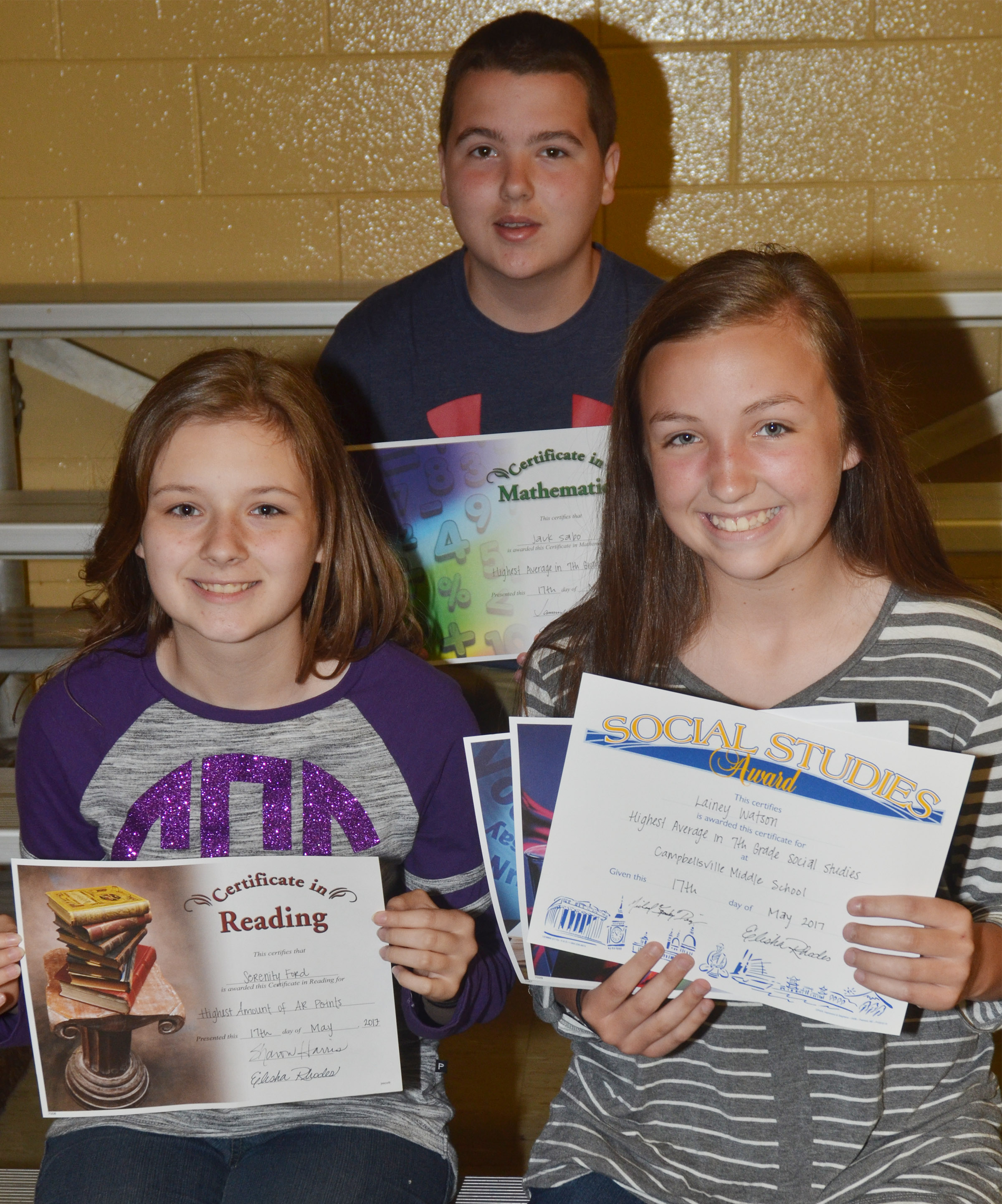 Seventh-grade subject award winners are, from left, front, Serenity Ford, accelerated reader; and Lainey Watson, social studies, science and language arts. Back, Jack Sabo, math.