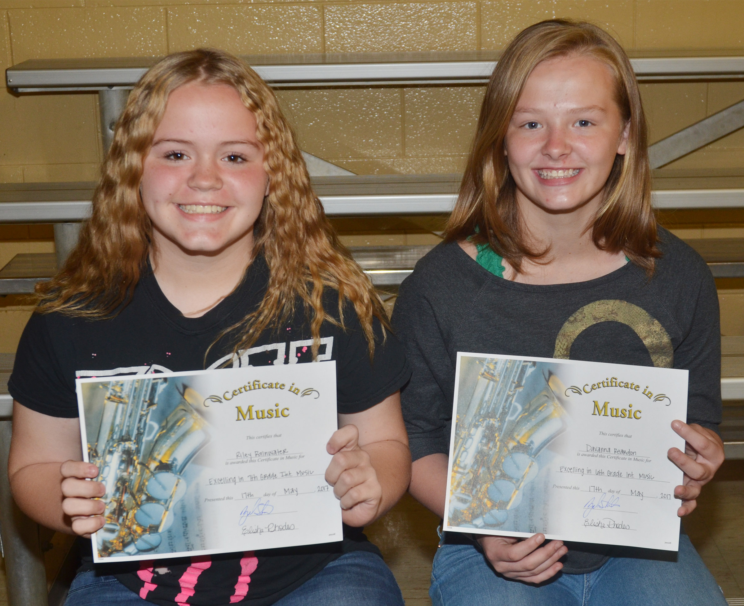 Instrumental music awards went to seventh-grader Riley Rainwater, at left, and sixth-grader Davanna Reardon.