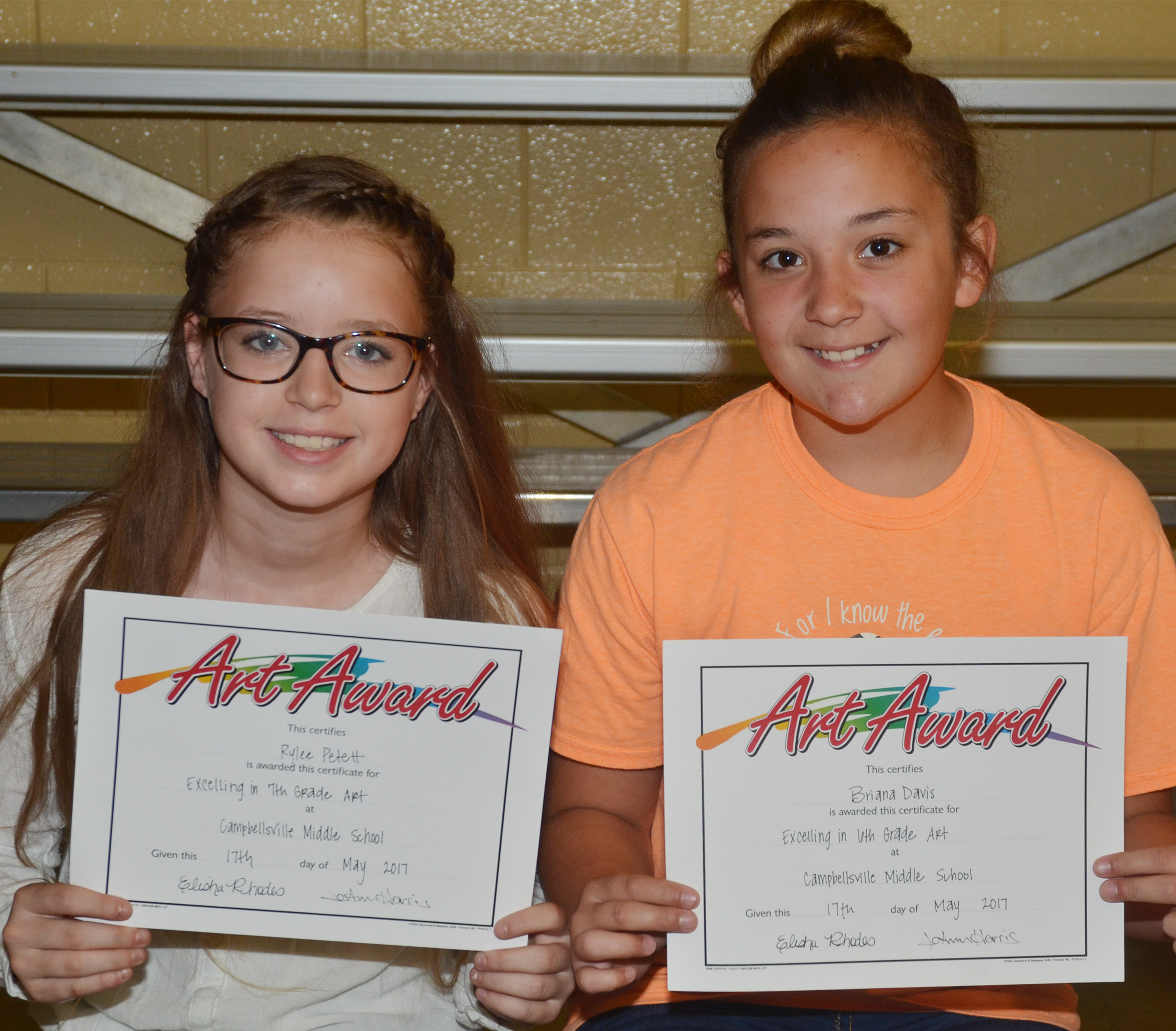 Art awards went to seventh-grader Rylee Petett, at left, and sixth-grader Briana Davis.