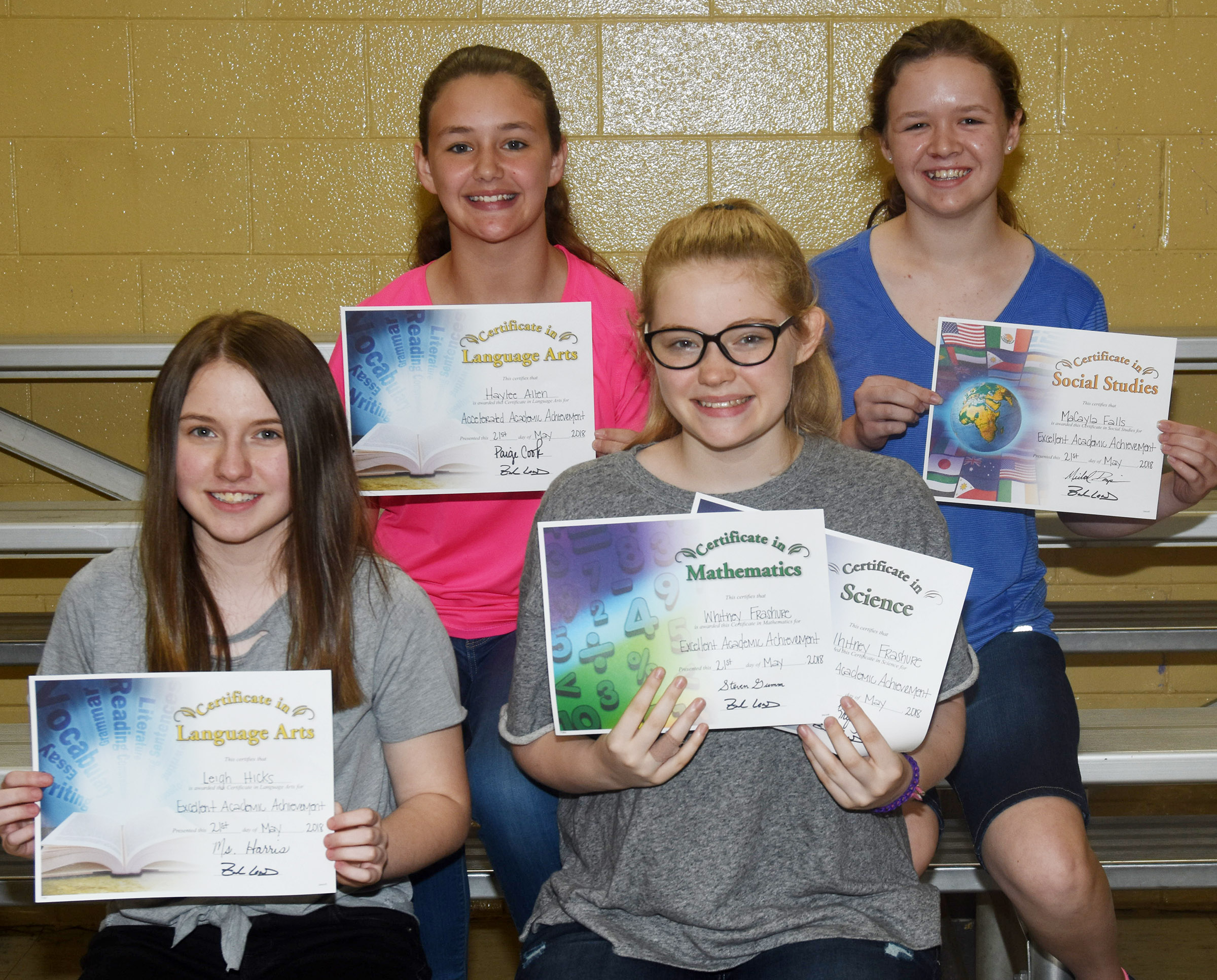 Seventh-grade subject award winners are, from left, front, Leigh Hicks, language arts; and Whitney Frashure, science and math. Back, Haylee Allen, accelerated language arts; and MaCayla Falls, social studies.