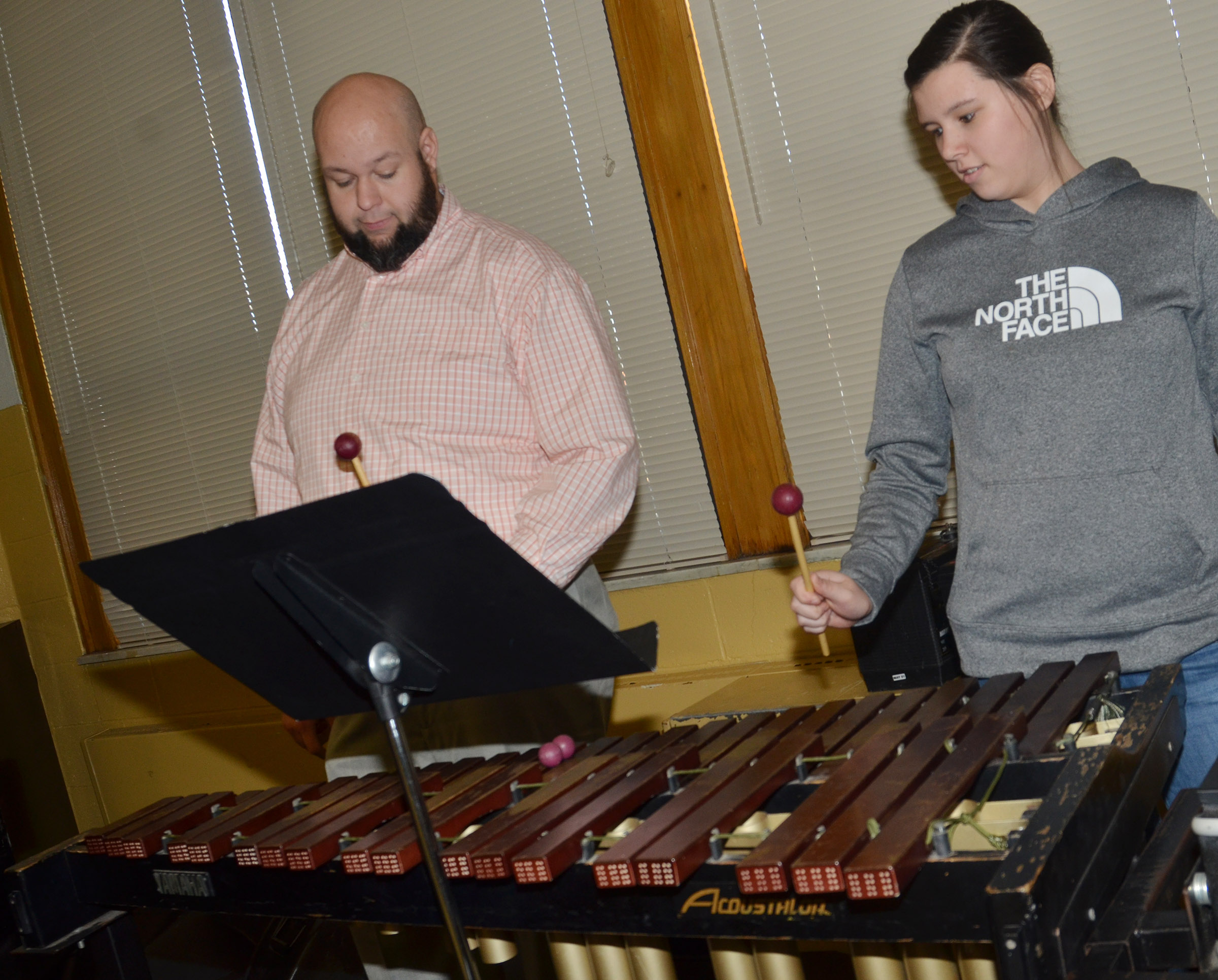 CMS eighth-grader Hannah Keith learns to play the mallets with band director Zach Shelton.