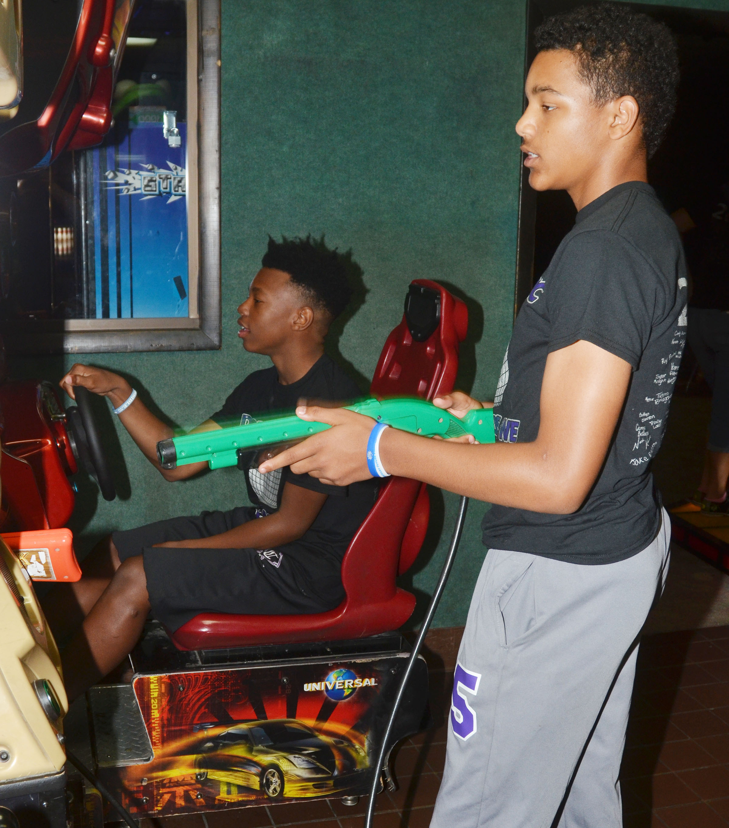 CMS eighth-graders Sae'von Buckner, at left, and Reggie Thomas play games.