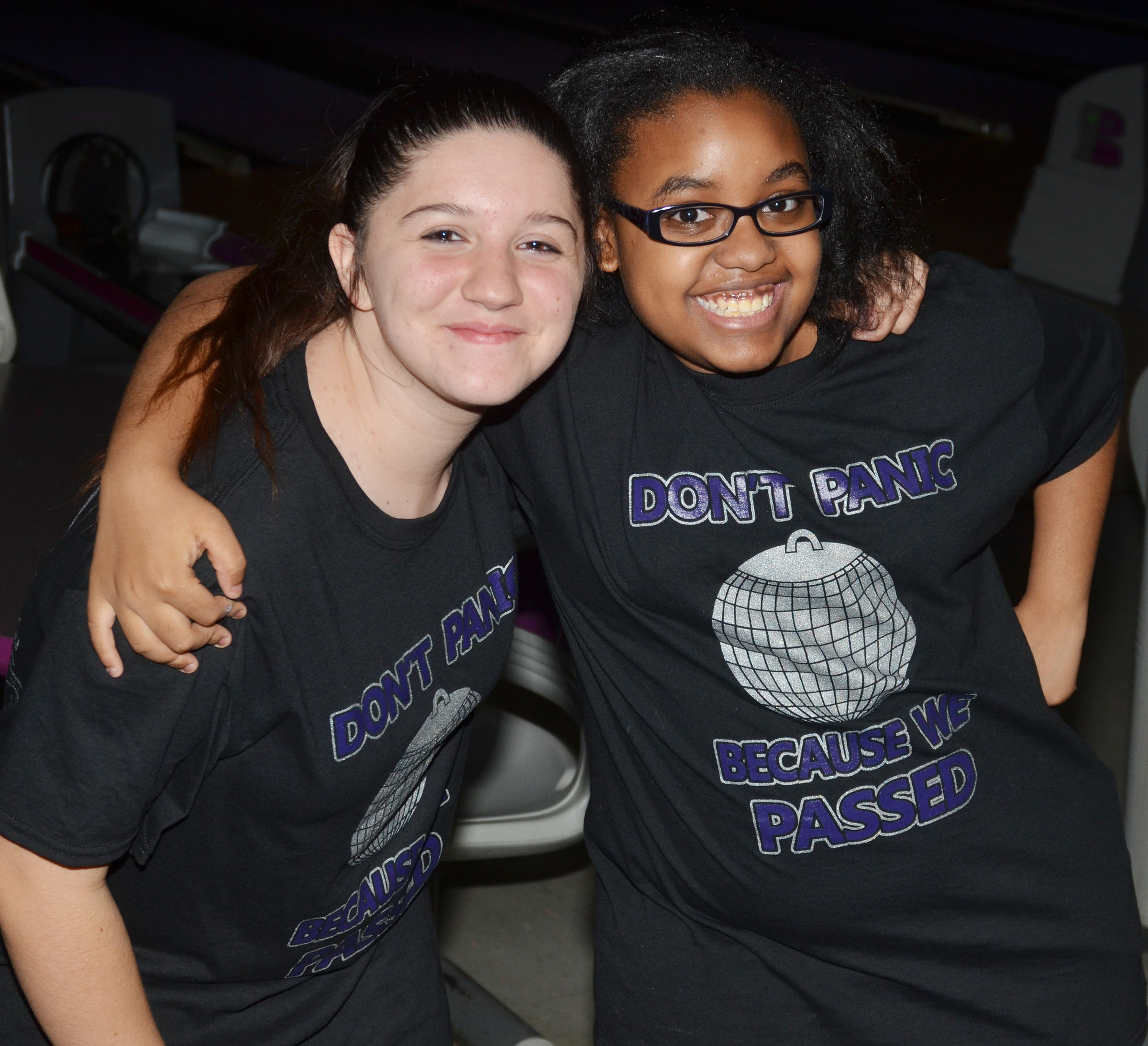 CMS eighth-graders Paula Hoskins, at left, and Cherica Mitchell smile for a photo together.