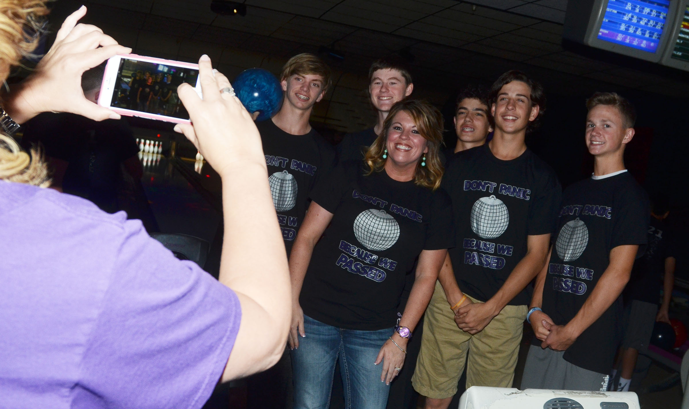 CMS Principal Elisha Rhodes smiles for a photo with eighth-graders, from left, Arren Hash, Tristin Faulkner, Kameron Smith, John Orberson and Blase Wheatley.