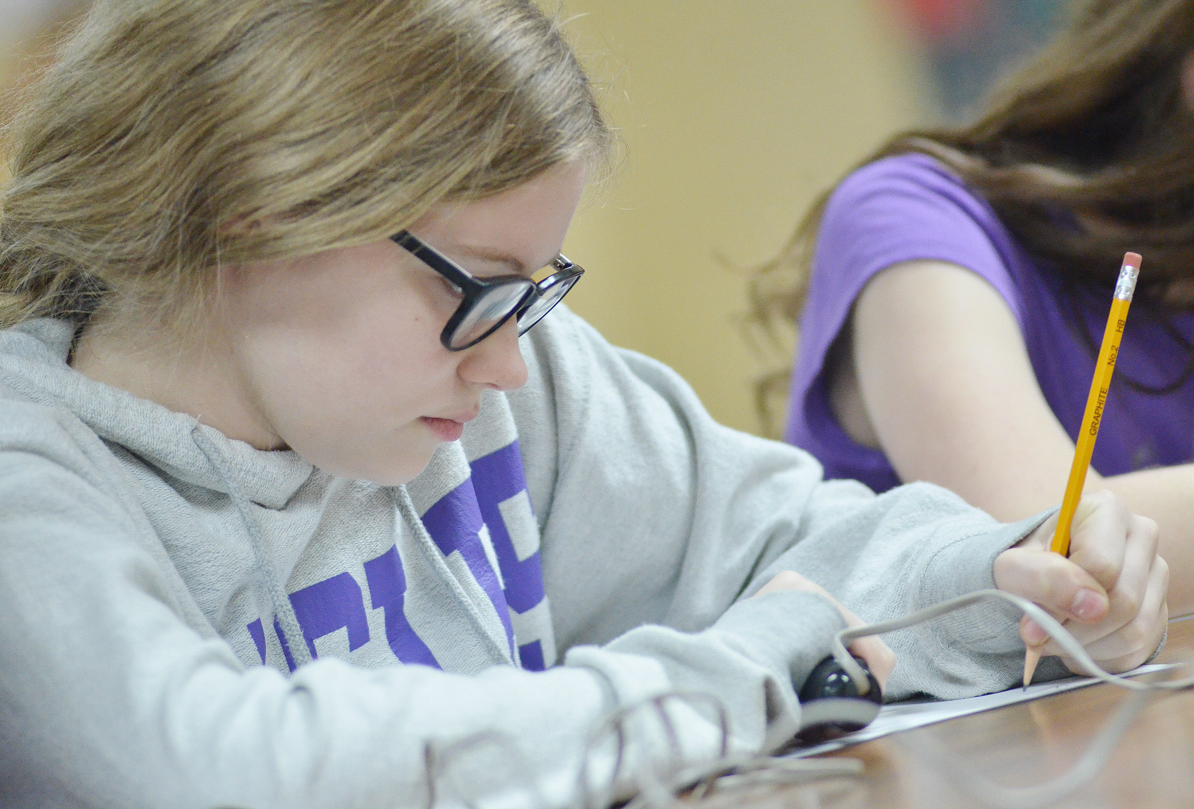 CMS seventh-grader Whitney Frashure works a math problem.