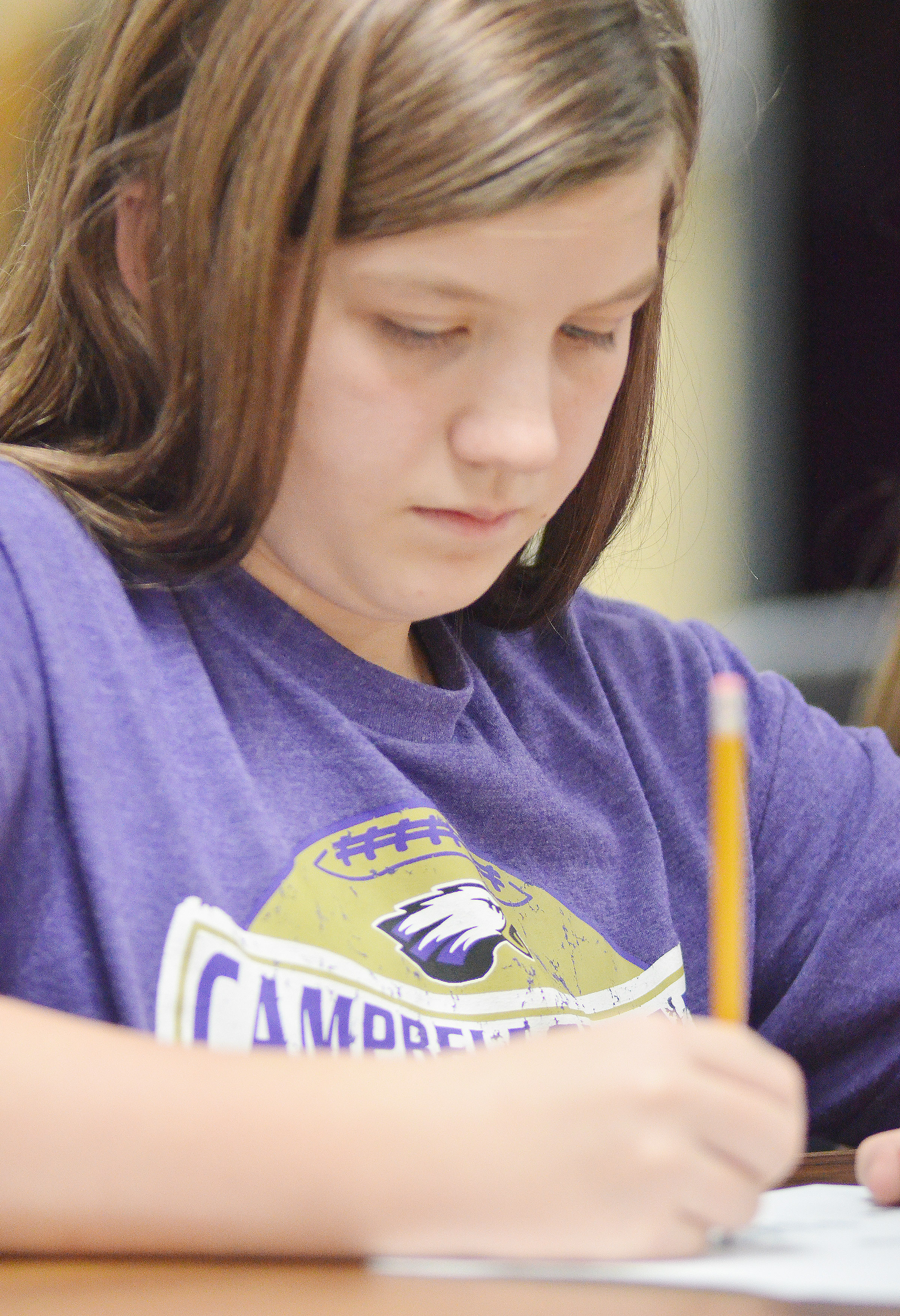 CMS seventh-grader Mikaela Scharbrough works a math problem.