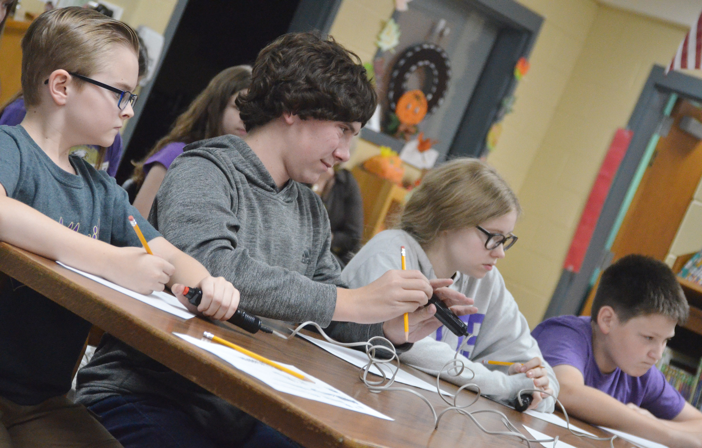 From left, CMS sixth-grader Caleb Holt, eighth-grader Peyton Dabney, seventh-grader Whitney Frashure and eighth-grader Bailey Stearman listen to a question.