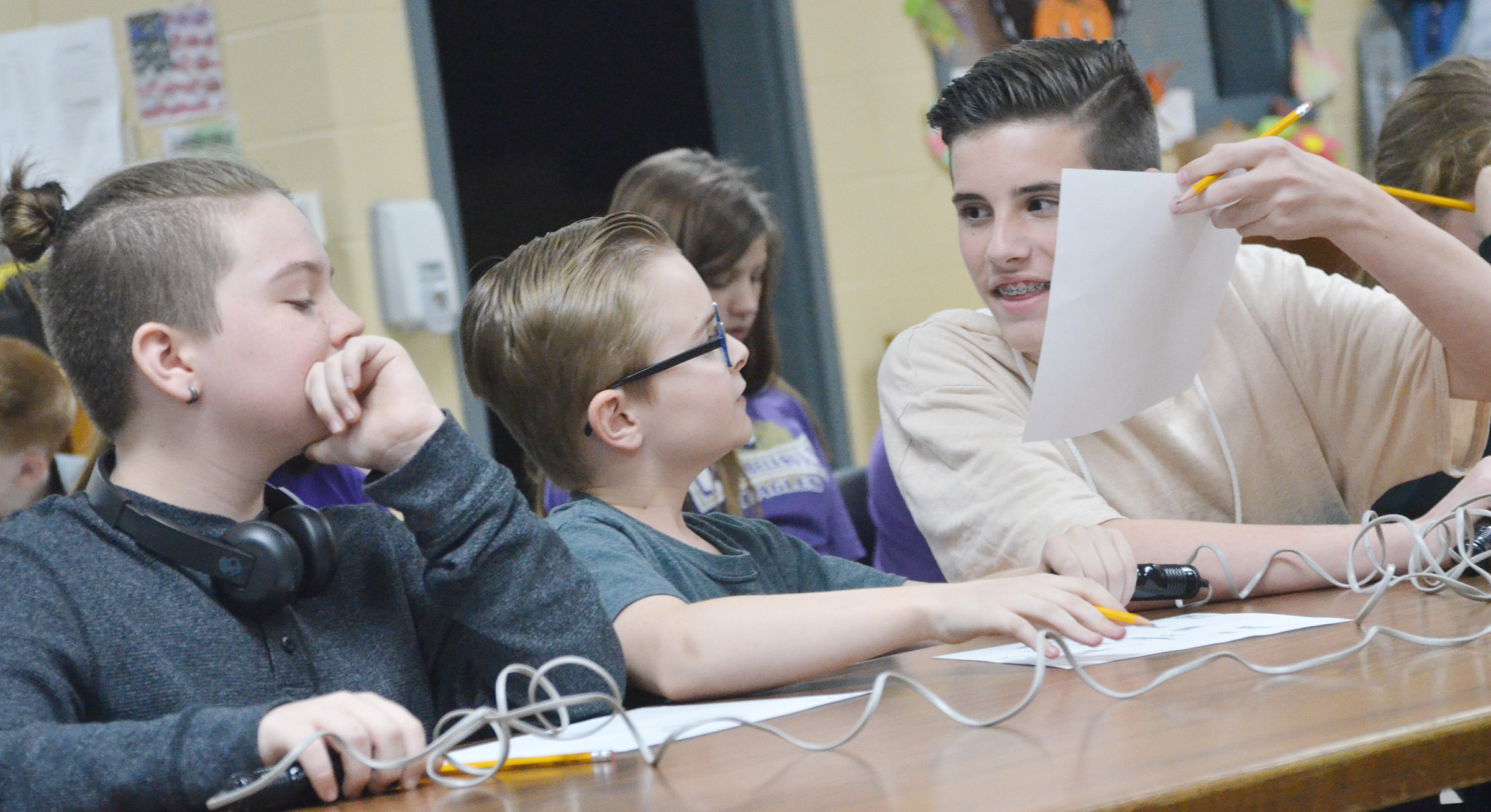 From left, sixth-graders Kayden Birdwell, Caleb Holt and Isaac Garrison discuss a question.