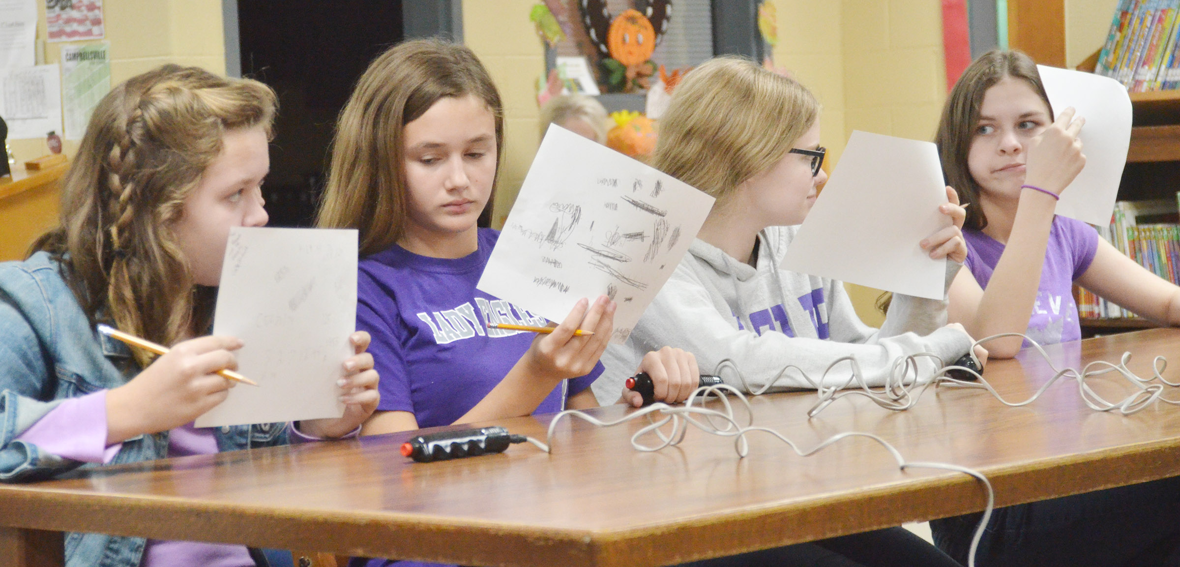 From left, CMS seventh-graders MaCayla Falls, Haylee Allen, Whitney Frashure and Karlee Rakel discuss a question.