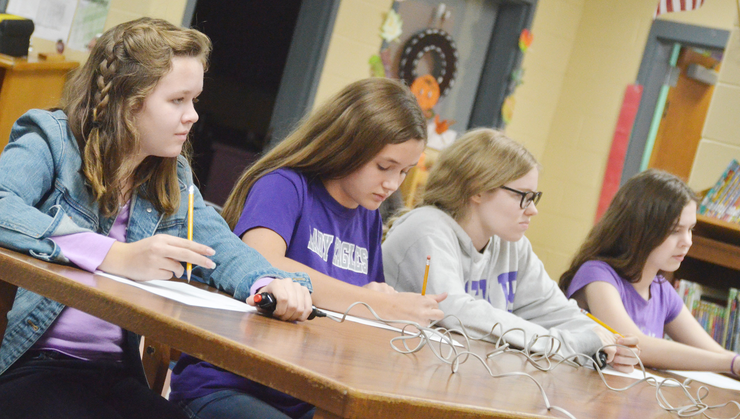 CMS seventh-graders, from left, MaCayla Falls, Haylee Allen, Whitney Frashure and Karlee Rakel, listen to a question.