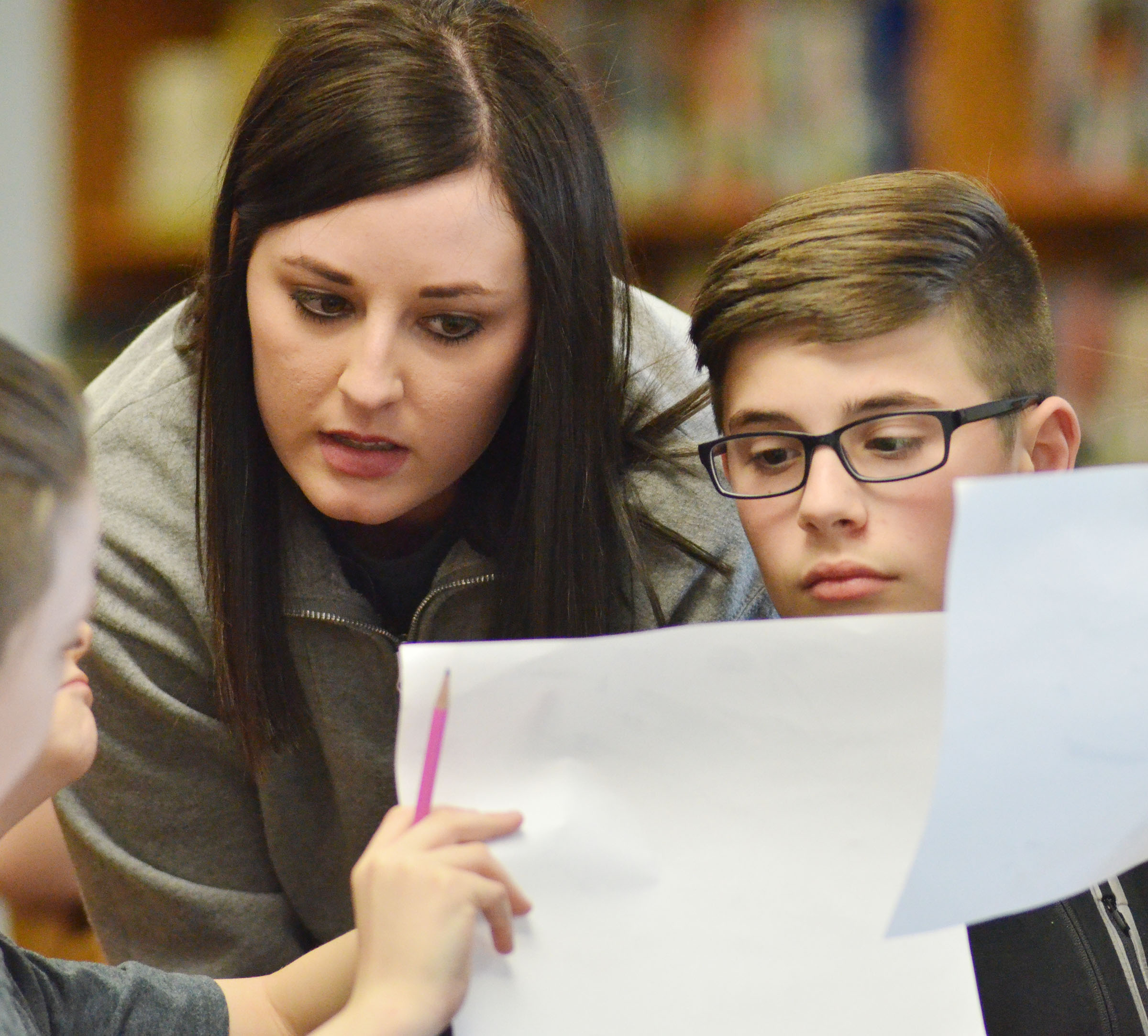 CMS fourth- and fifth-grade academic team coach Samantha Coomer talks to fifth-grader Isaac Garrison and his quick recall teammates before a match.