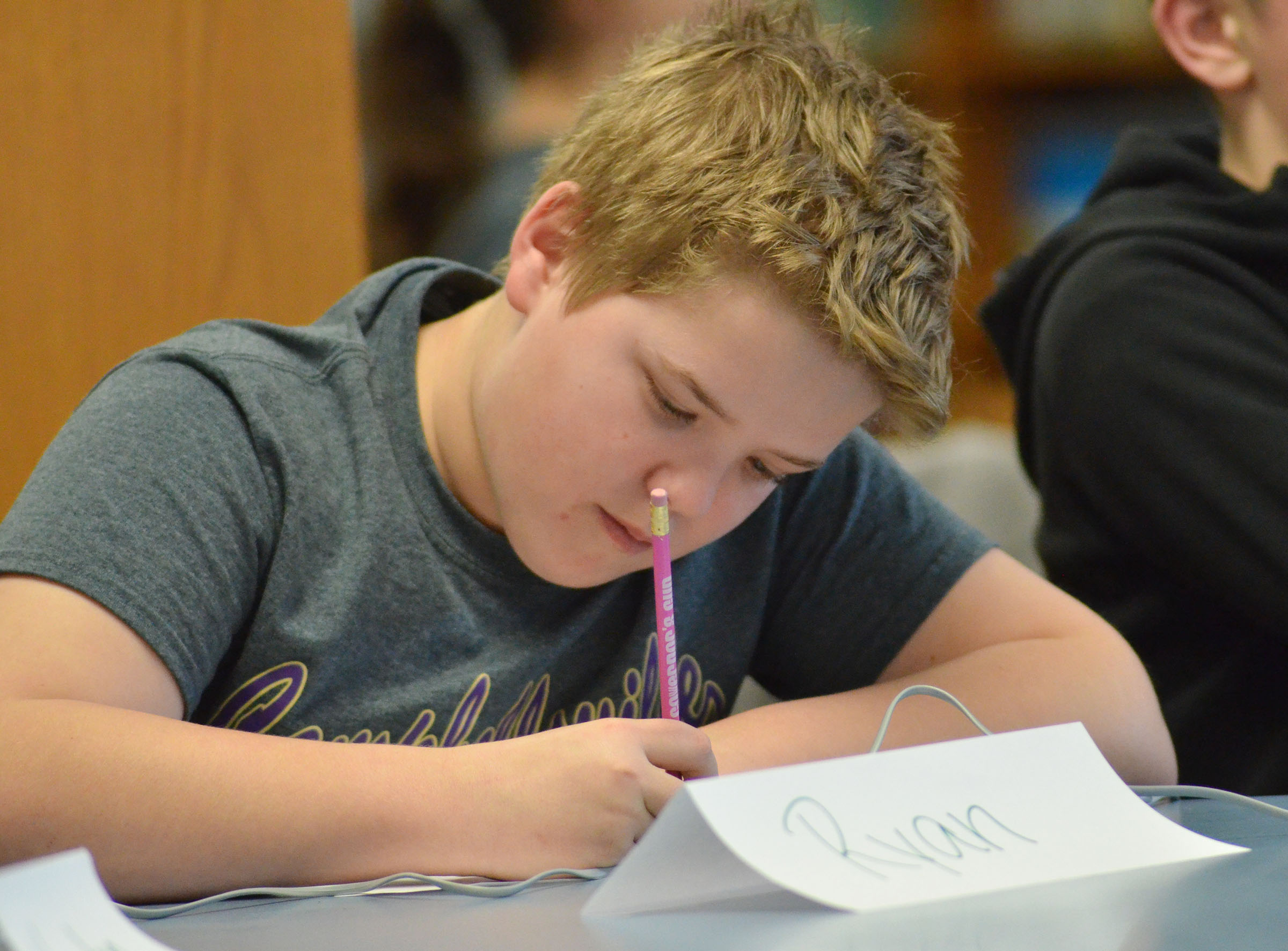 CMS fifth-grader Ryan Grubbs works a math problem.