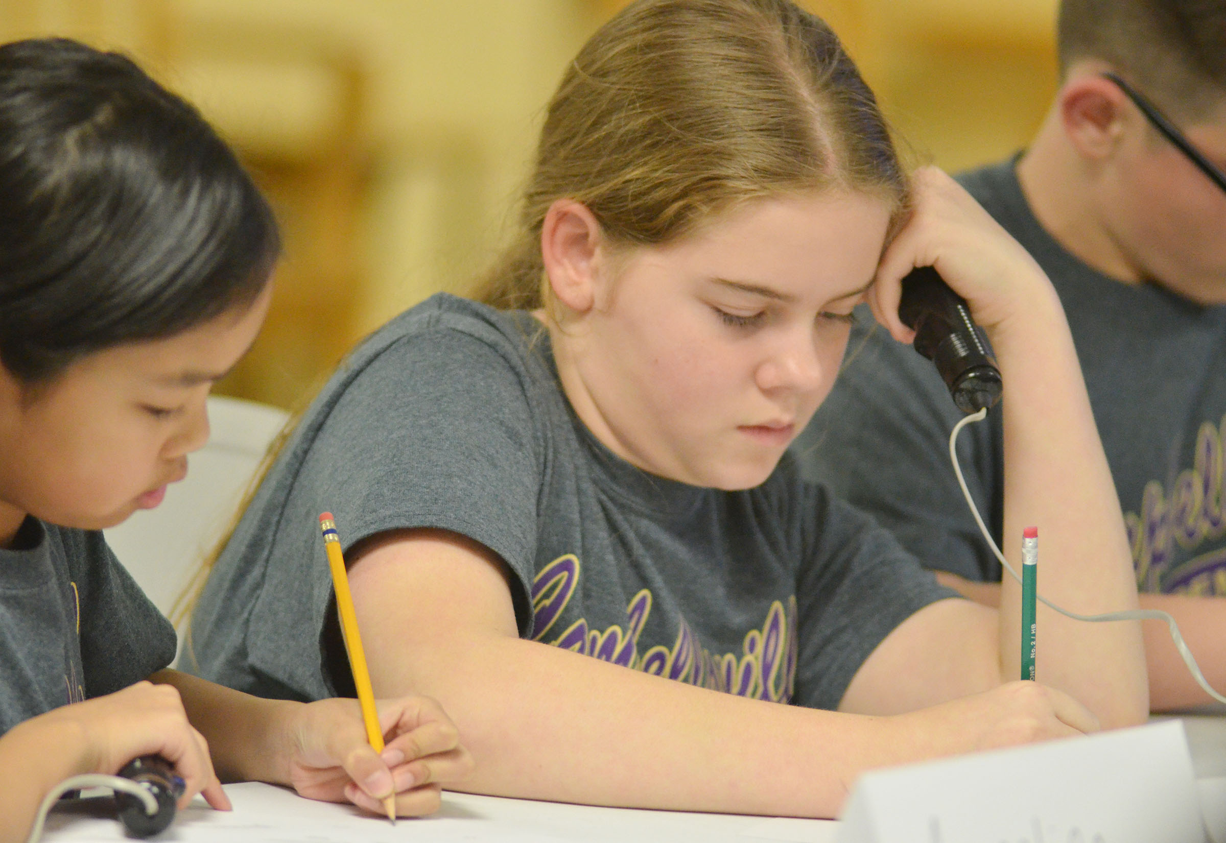 CMS fifth-graders Angelica Seng, at left, and Layla Steen work a math problem.