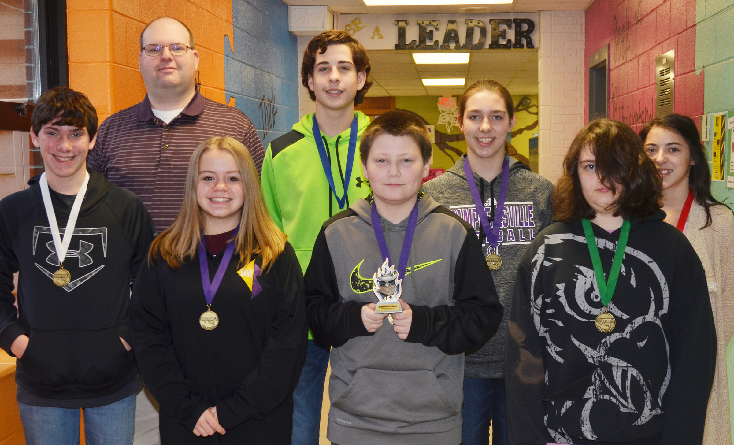 CMS academic team members advancing to region competition are, from left, front, seventh-graders Peyton Dabney, Riley Rainwater and Bailey Stearman and eighth-grader Haley Lopez. Back, coach Steven Gumm, eighth-graders John Orberson and Abi Wiedewitsch and seventh-grader Kaylyn Smith.