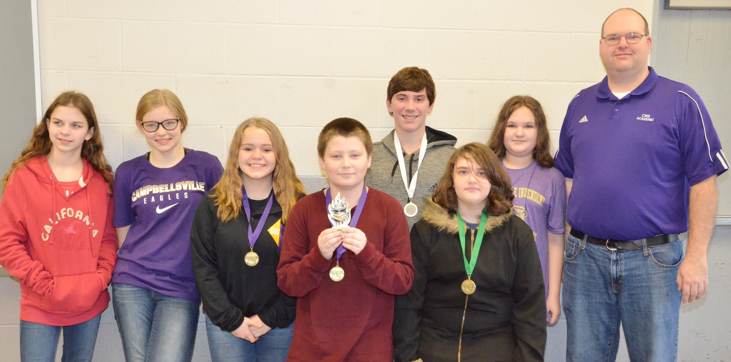 CMS academic team members competing at district competition are, from left, sixth-graders Karlee Rakel and Whitney Frashure, seventh-graders Riley Rainwater, Bailey Stearman and Peyton Dabney, eighth-grader Haley Lopez, sixth-grader Savannah Gumm and coach Steven Gumm.