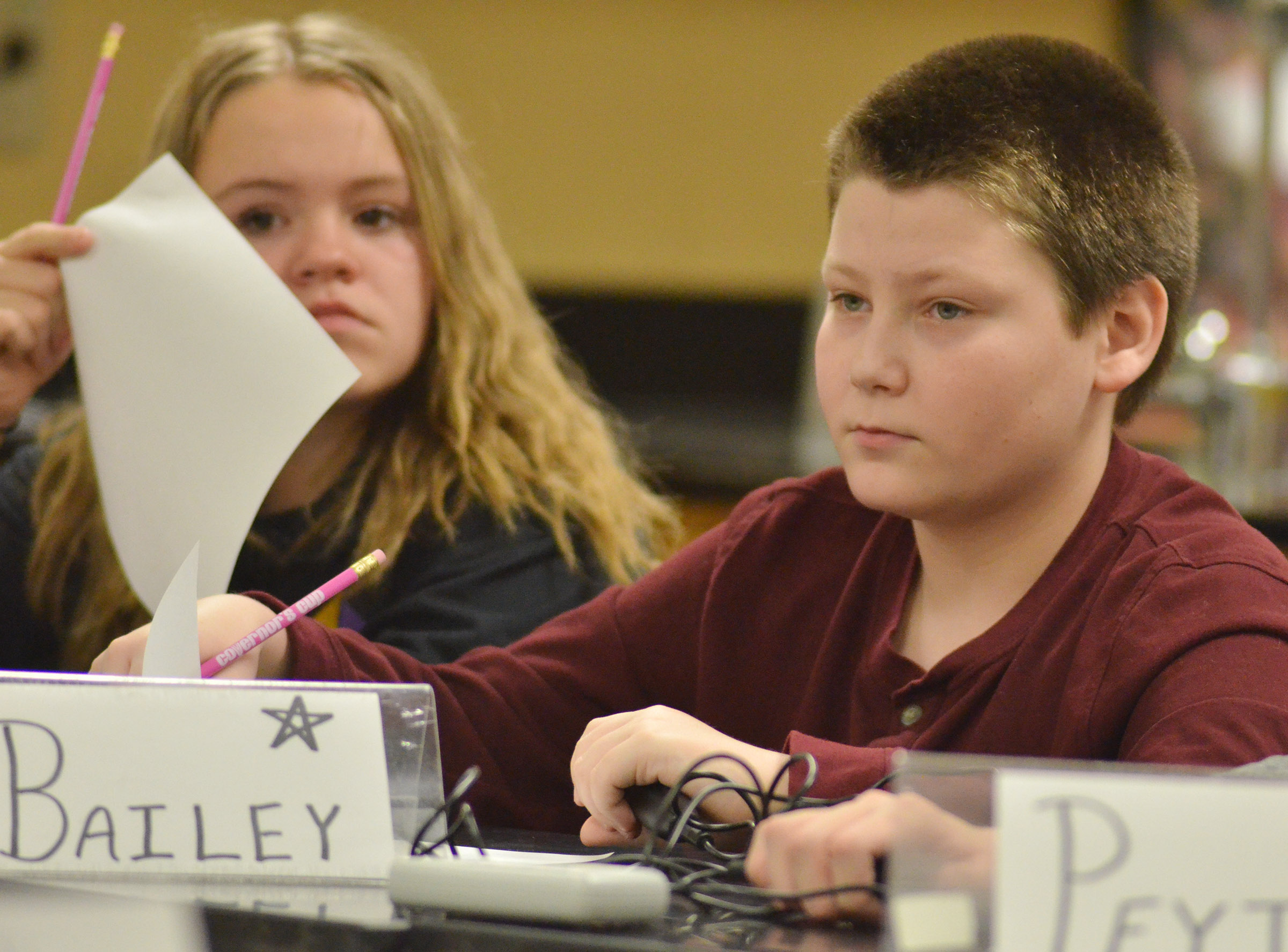 CMS seventh-graders Riley Rainwater, at left, and Bailey Stearman listen to a quick recall question.