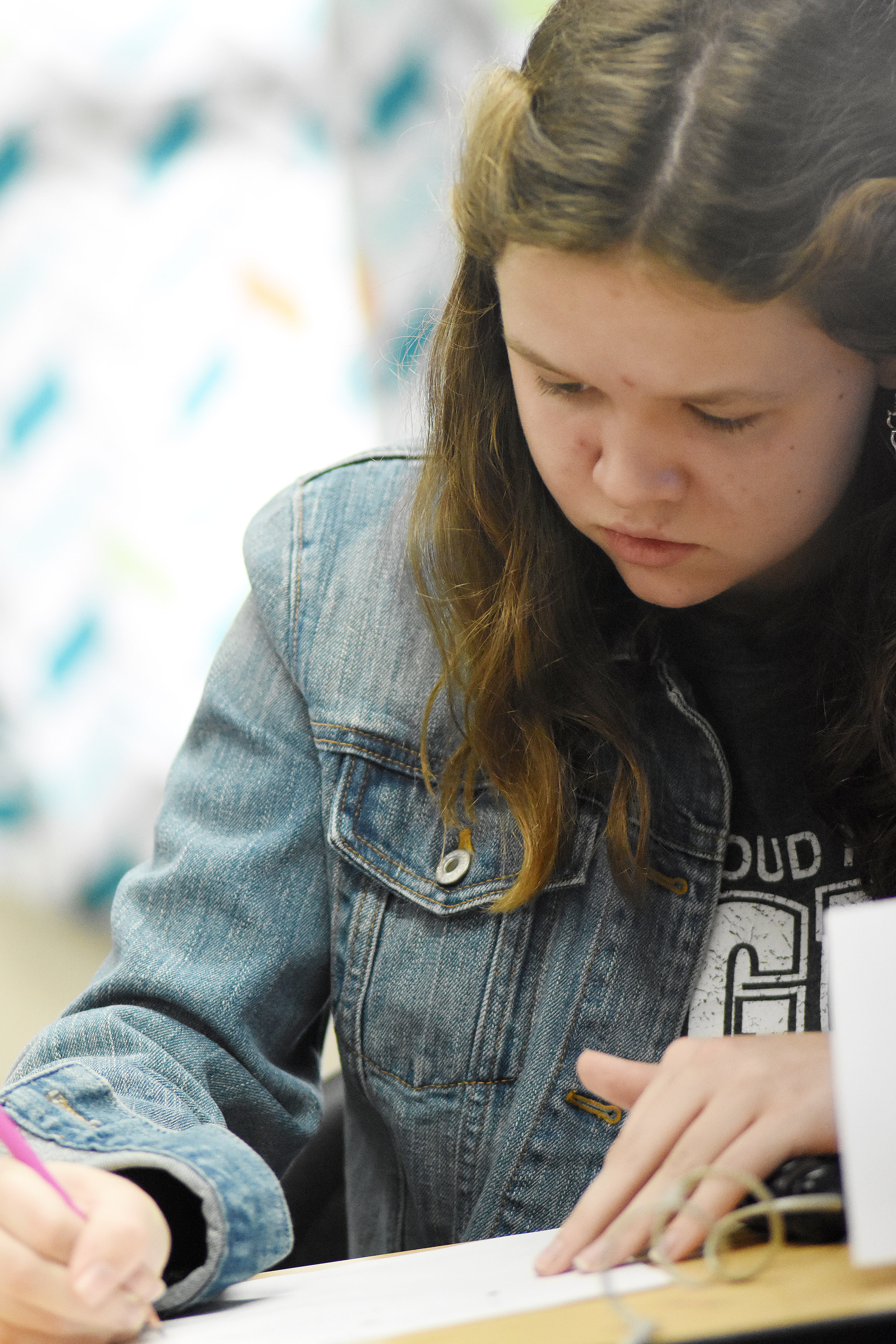 CMS seventh-grader MaCayla Falls works a math problem during a quick recall match.
