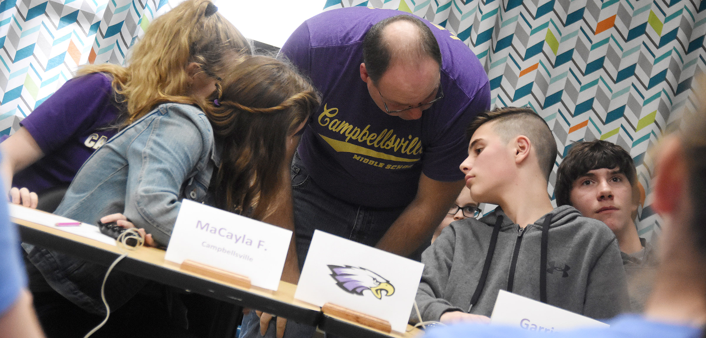 CMS academic teach coach Steven Gumm talks to quick recall players, from left, seventh-graders Whitney Frashure and MaCayla Falls, sixth-grader Isaac Garrison and eighth-grader Peyton Dabney.