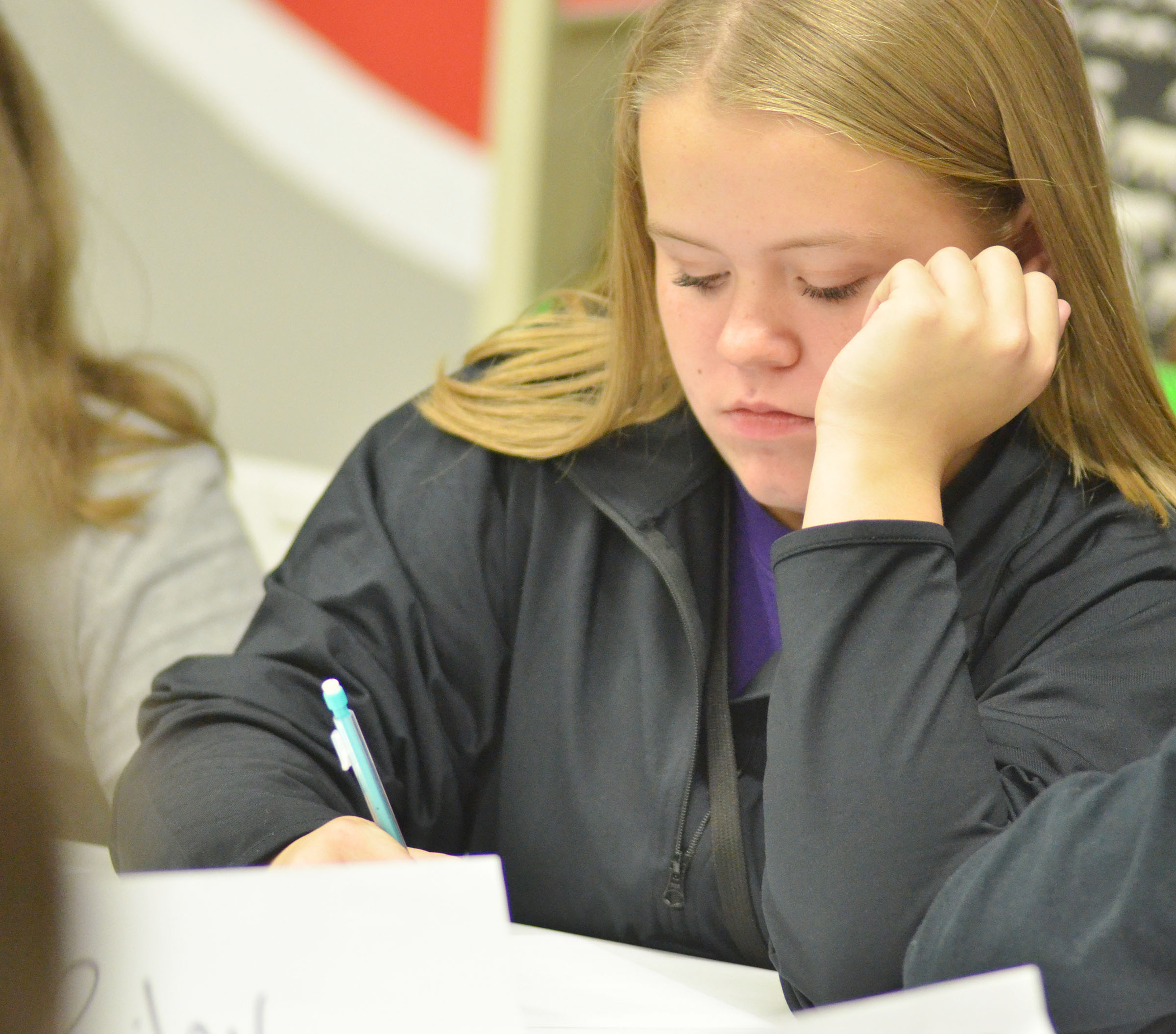 CMS seventh-grader Riley Rainwater works a math problem.