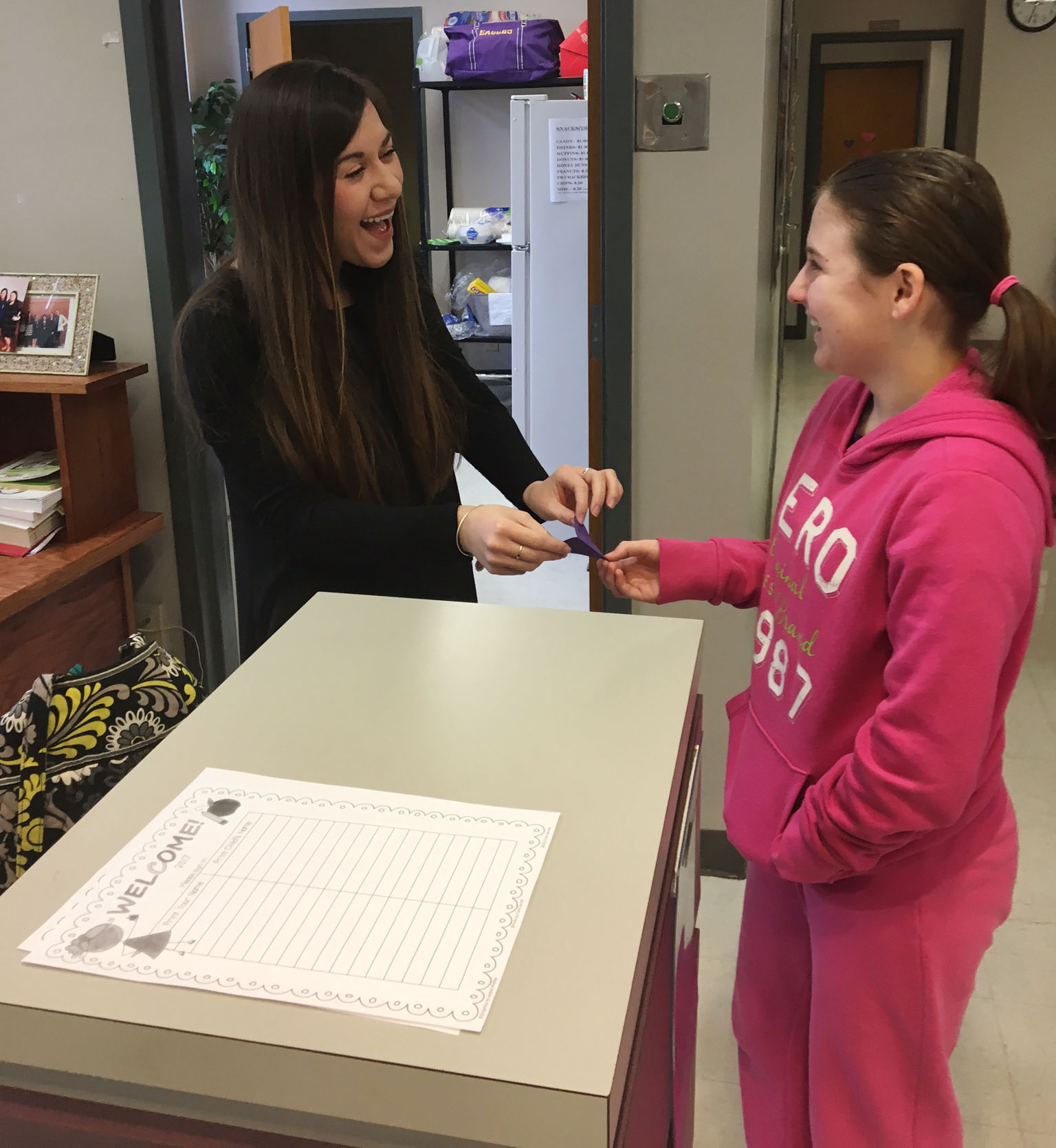 CMS sixth-grader Leigh Hicks gives a Valentine to Courtney Mills, CMS guidance secretary.