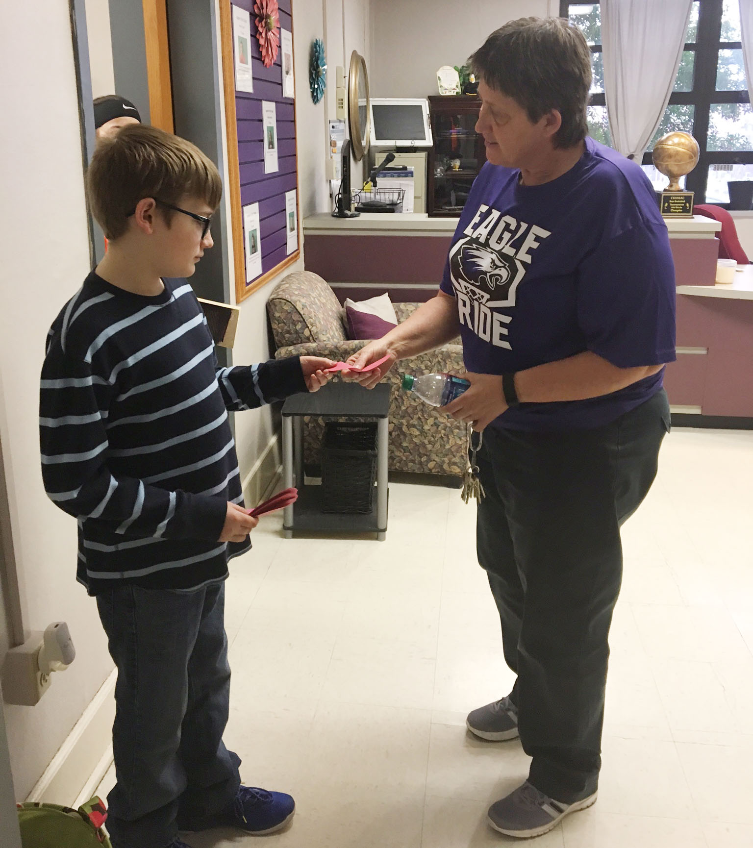 CMS sixth-grader Brady Hoosier delivers a Valentine to special education teacher Katie Wilkerson.