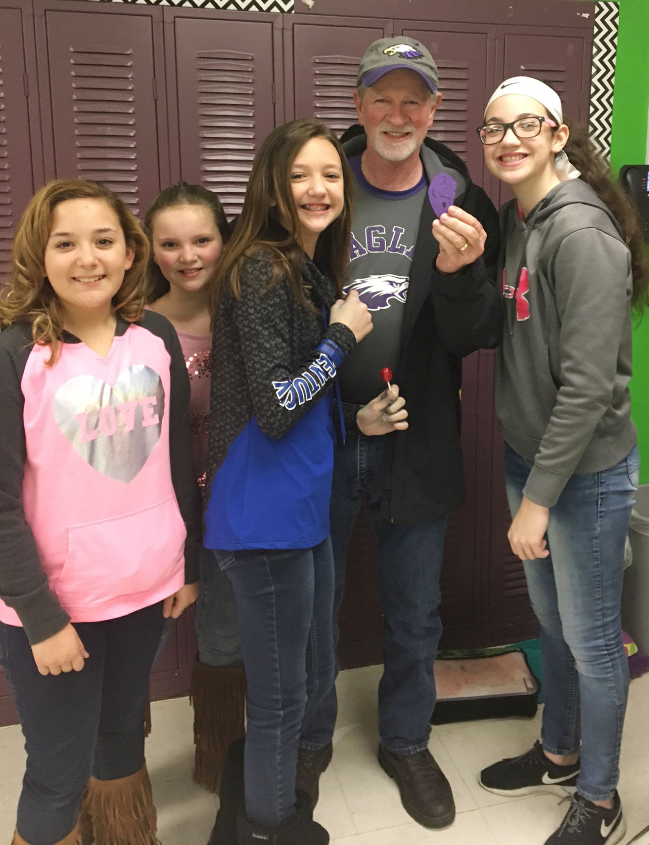 CMS sixth-graders, from left, Briana Davis, Graci Crews, Bri Hayes and Mary Russell deliver a Valentine to custodial worker Daryl Ford.