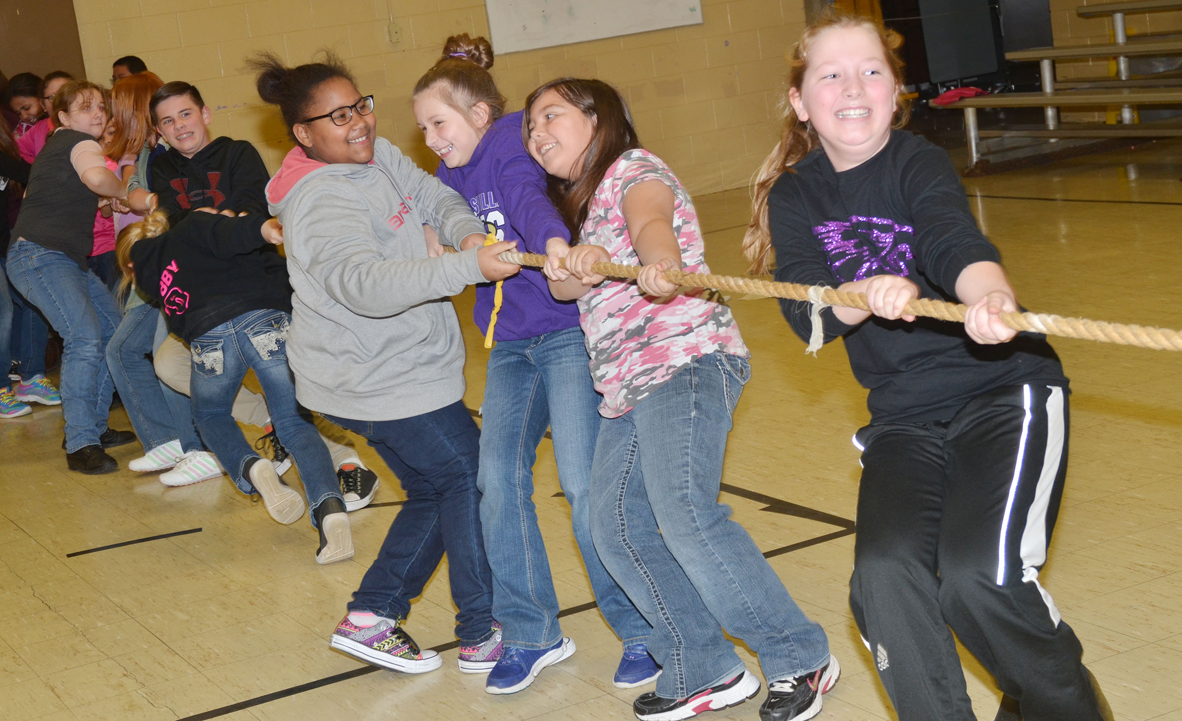 CMS fifth-graders, led by Ava Hughes, pull the rope as they battle in tug of war.