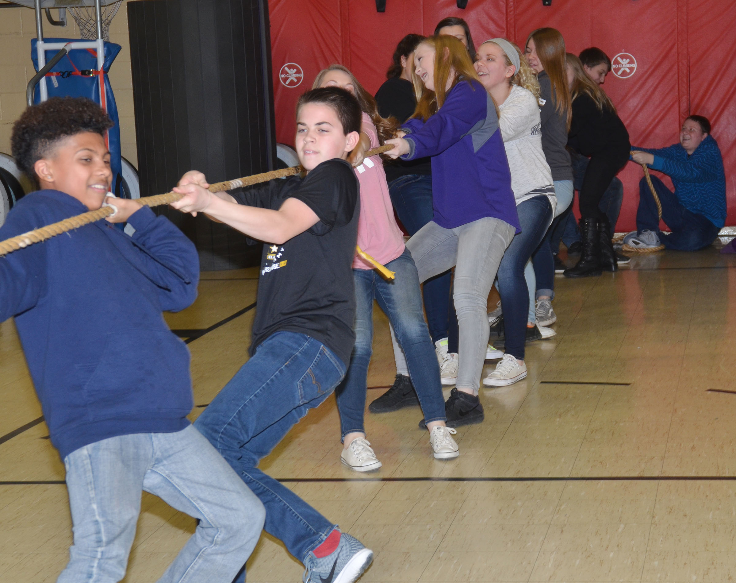 CMS eighth-graders, led by Lorenzo Coulter, pull the rope as they battle in tug of war.