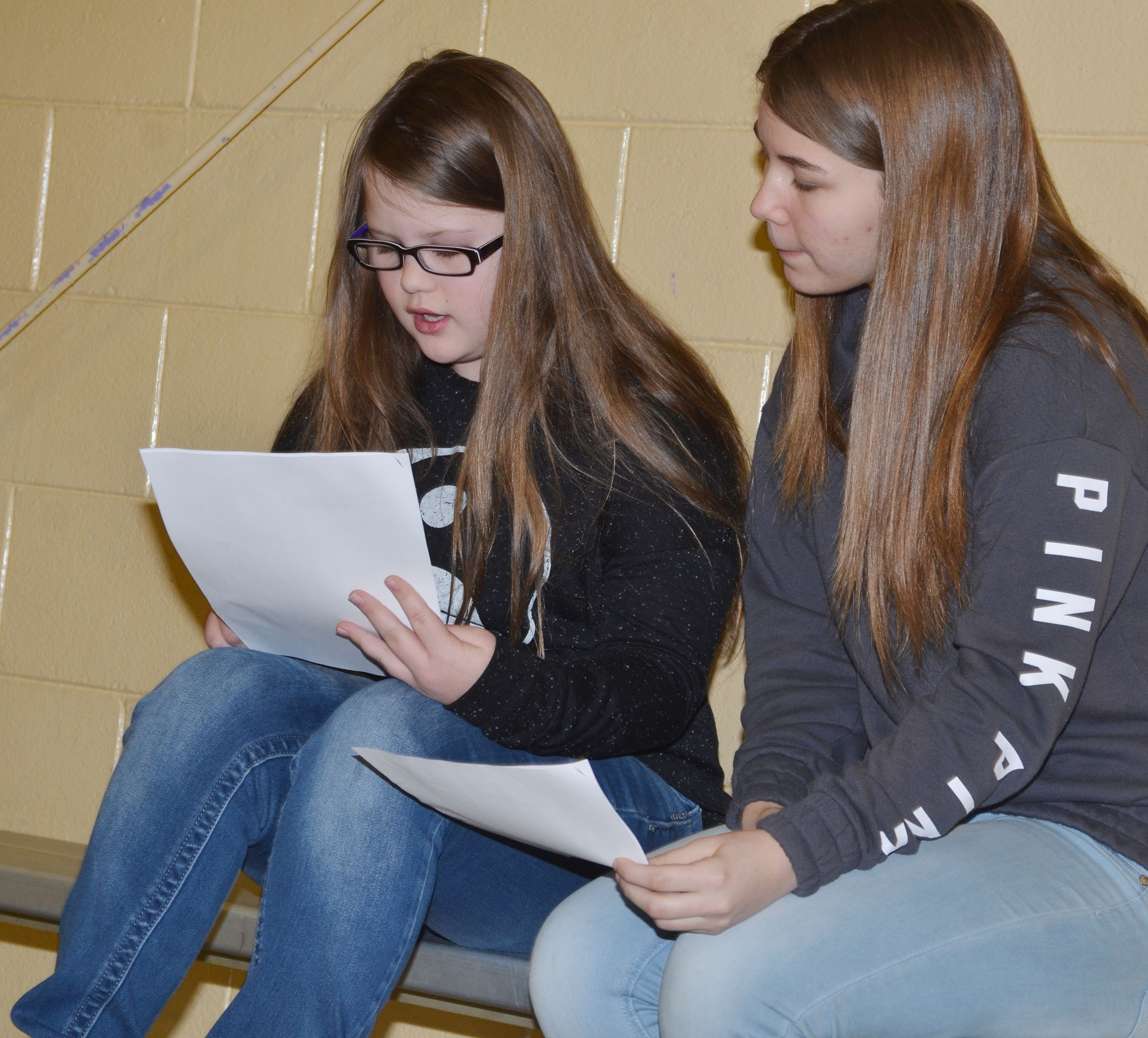 CMS fifth-grader Kylee Cox, at left, works with eighth-grader MaKala Hammett to answer questions about the American Revolution.