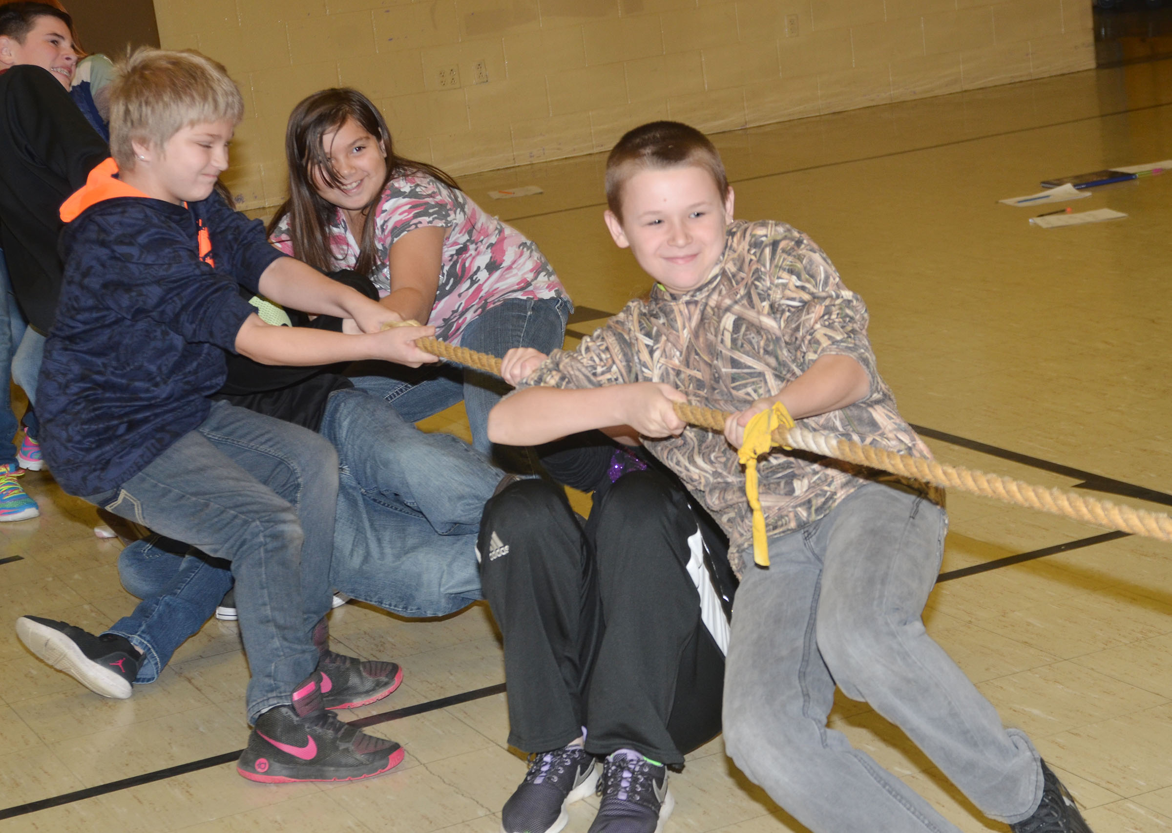 CMS fifth-graders, led by Kasey Sluder, pull the rope as they battle in tug of war.